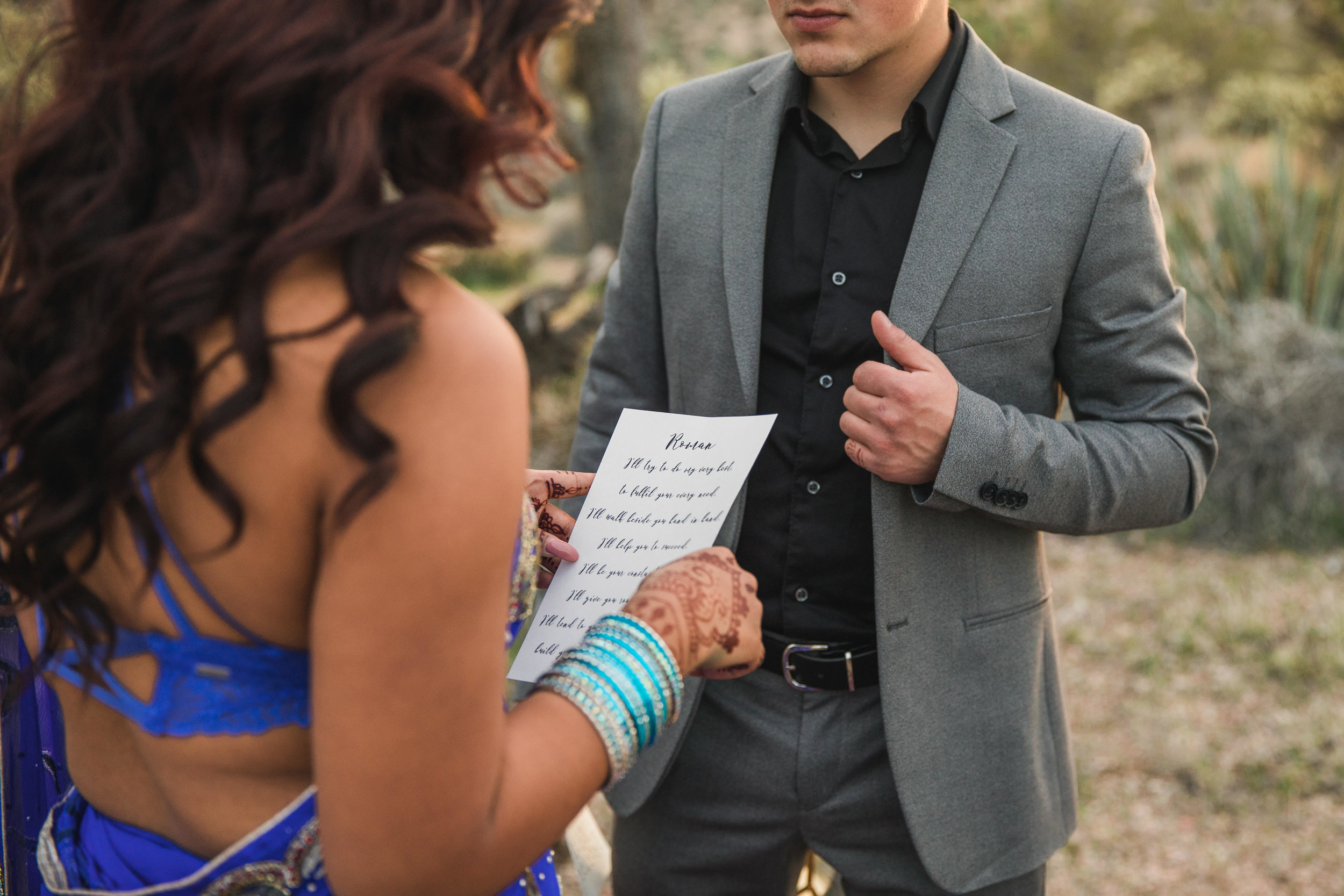Bride's exchanges vows with her groom in the Joshua Tree Desert of Utah Kyle Loves Tori Photography