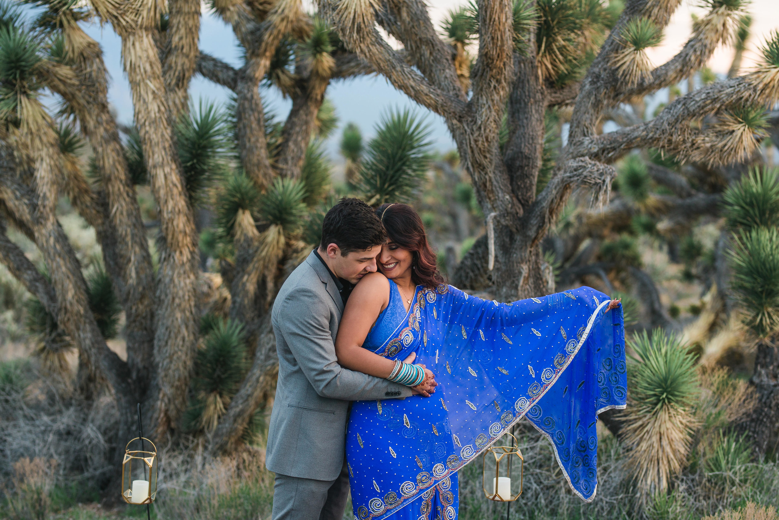 Bride's beautiful traditional sari snuggles her groom in the desert Kyle Loves Tori Photography