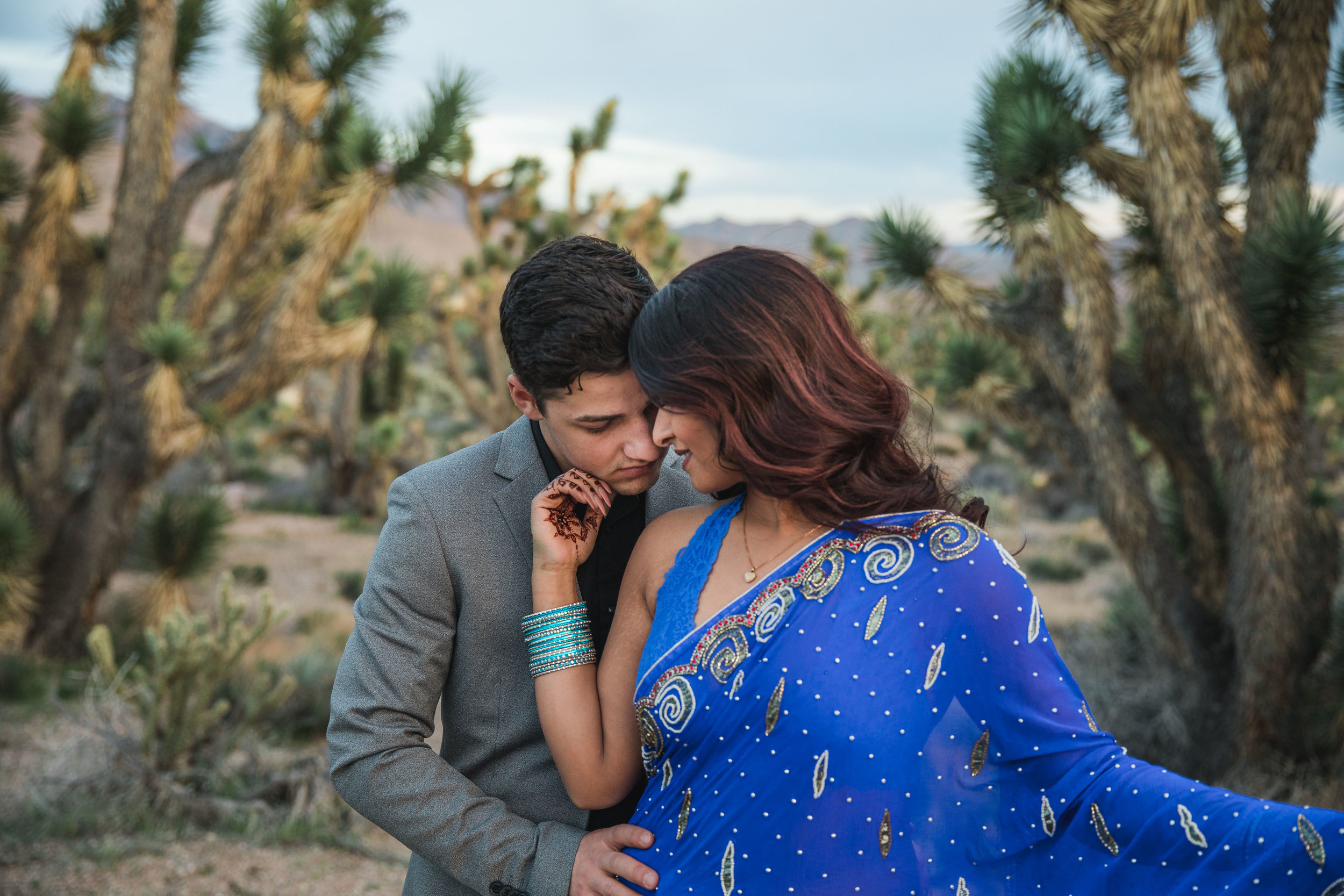 Indian bride and Russian groom elope in the desert and snuggle together Kyle Loves Tori Photography