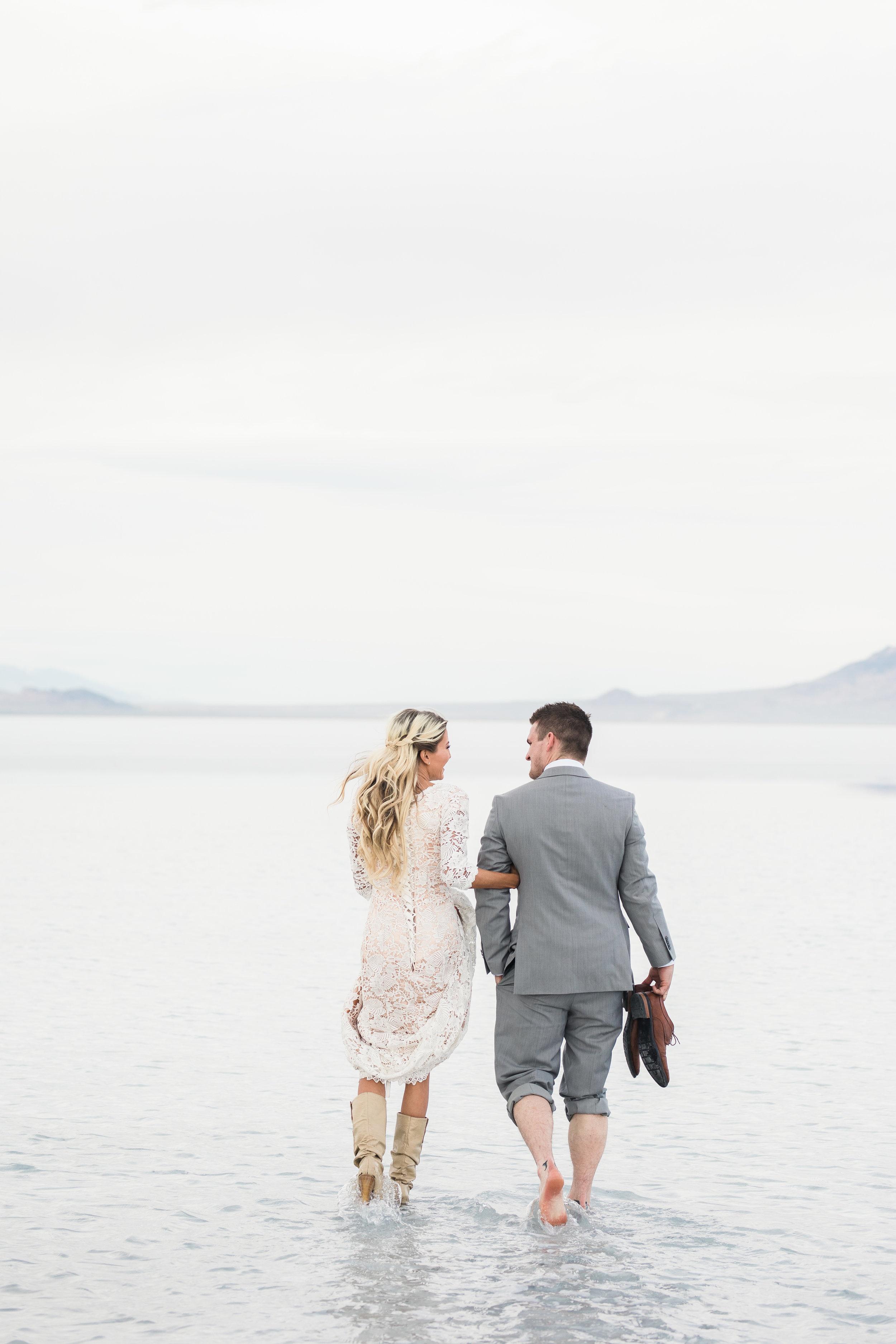 Bride and groom walking through water Bonneville Salt Flats Utah bridals