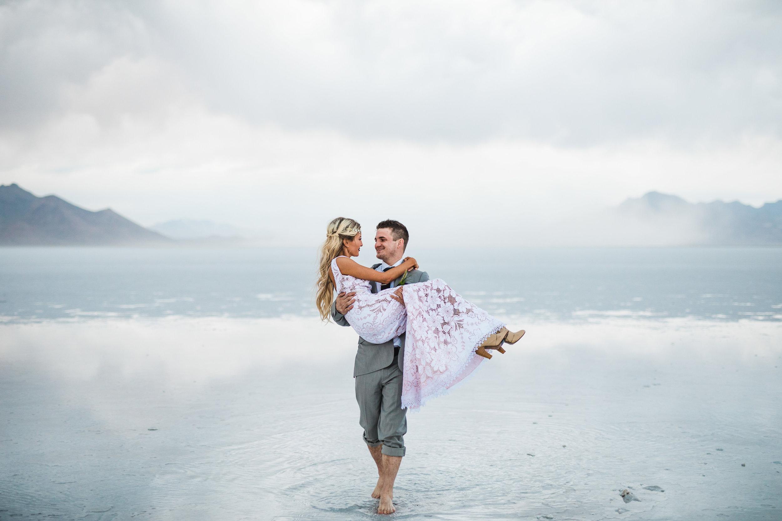Bride and groom walking across the water unique wedding pictures Bonneville Salt Flats