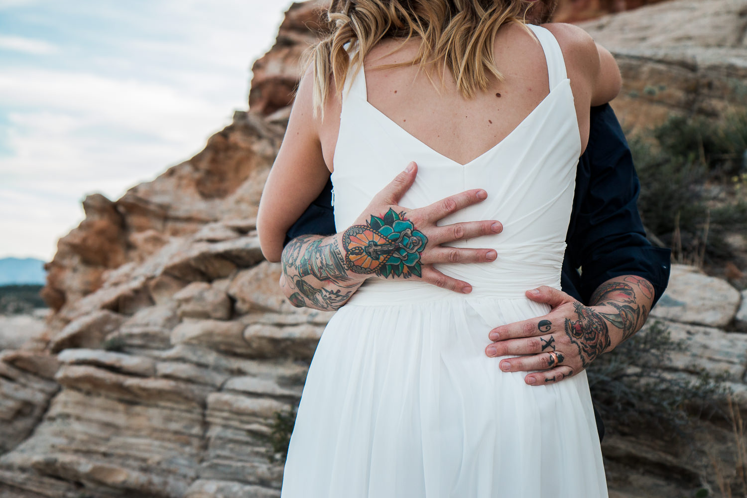 Tattooed couple exchange vows at an epic canyon overlook Southern Utah