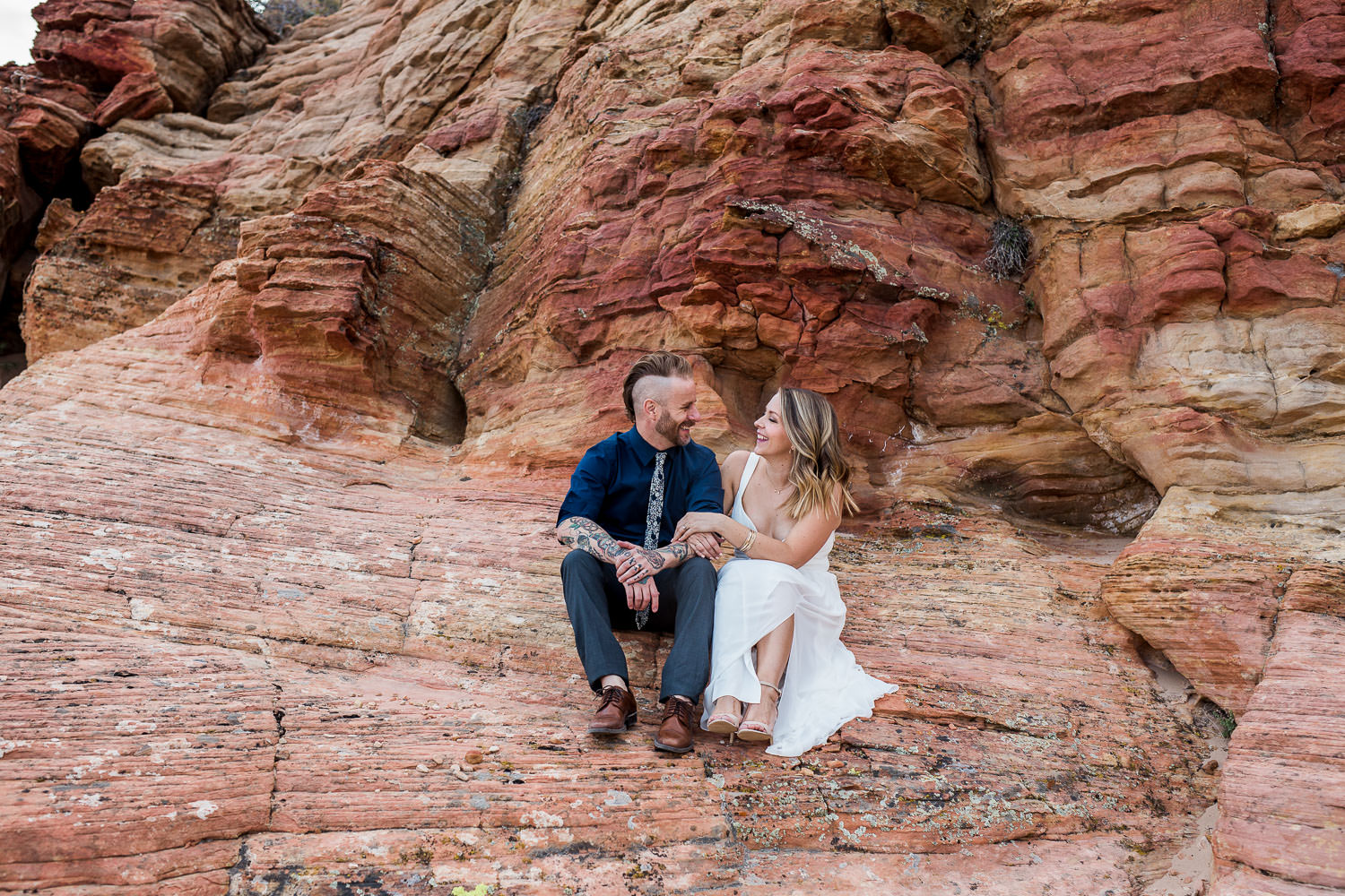 Husband and wife wedding photographer red rock vow renewal utah
