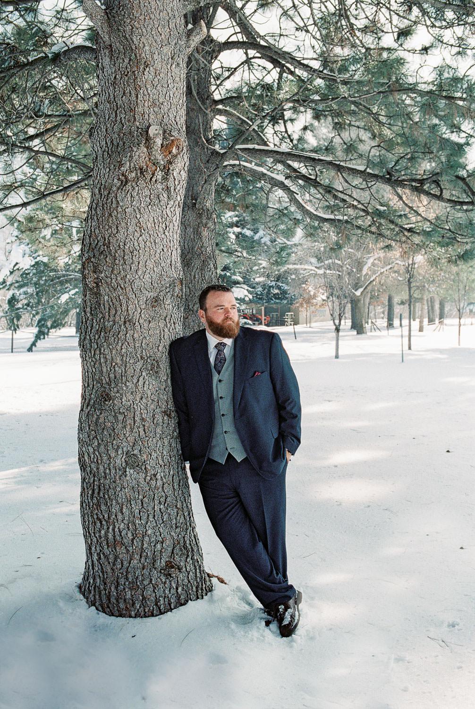 Classy winter wedding groom attire fine art film photography