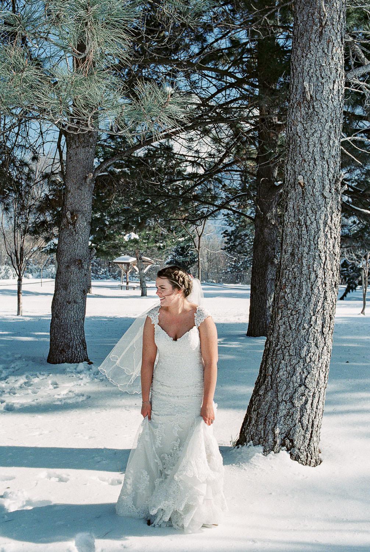 Winter wedding bride in Maggie Sottero dress fine art film photography