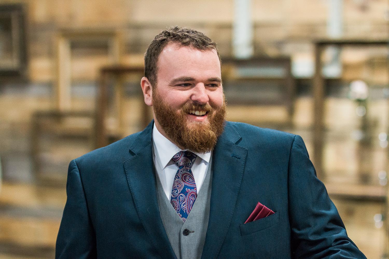 Winter wedding groom's first look