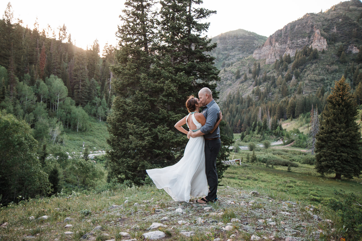 Dynamic couples pose by adventure photographers in Utah