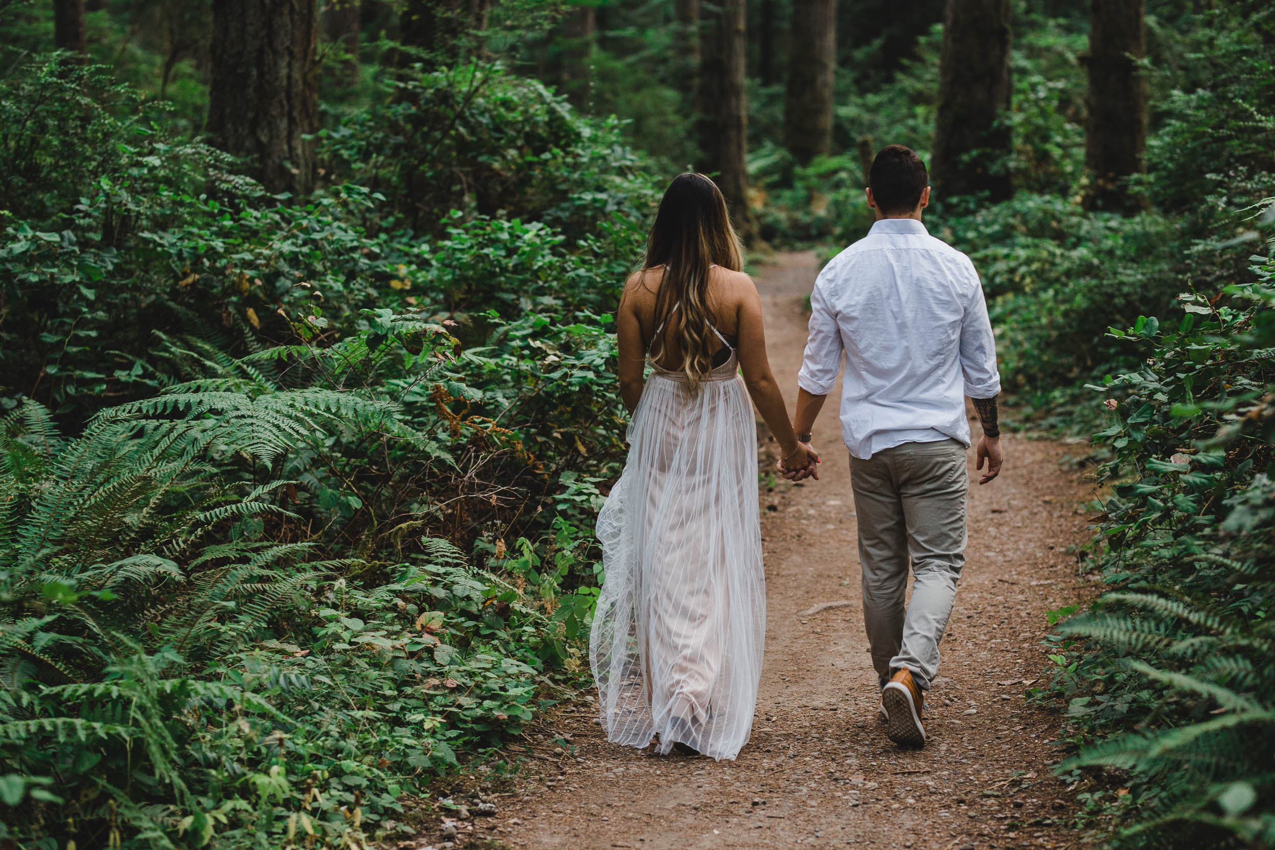 Bride and Groom walking through Grand Forest