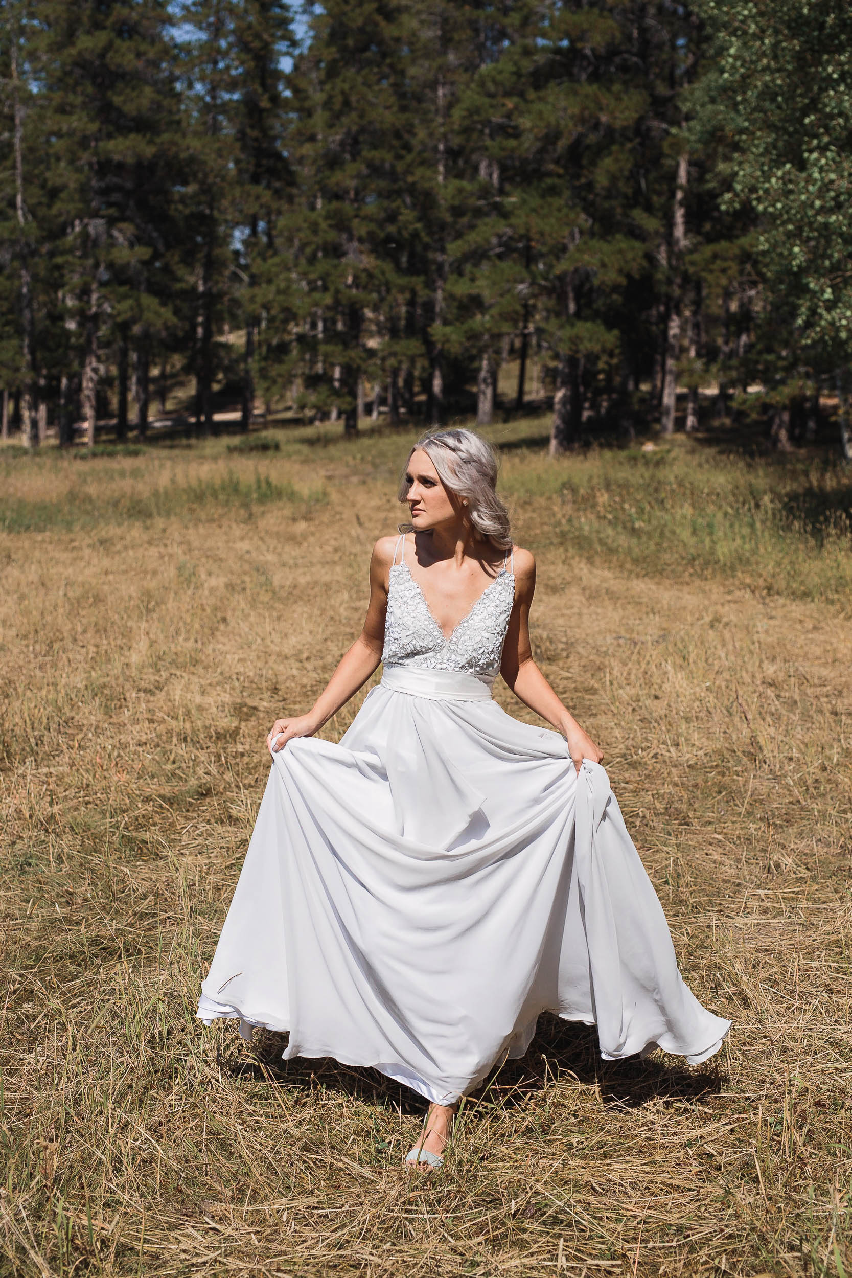 Elegant bride in Truvelle Bridal dress harsh light wedding portraits