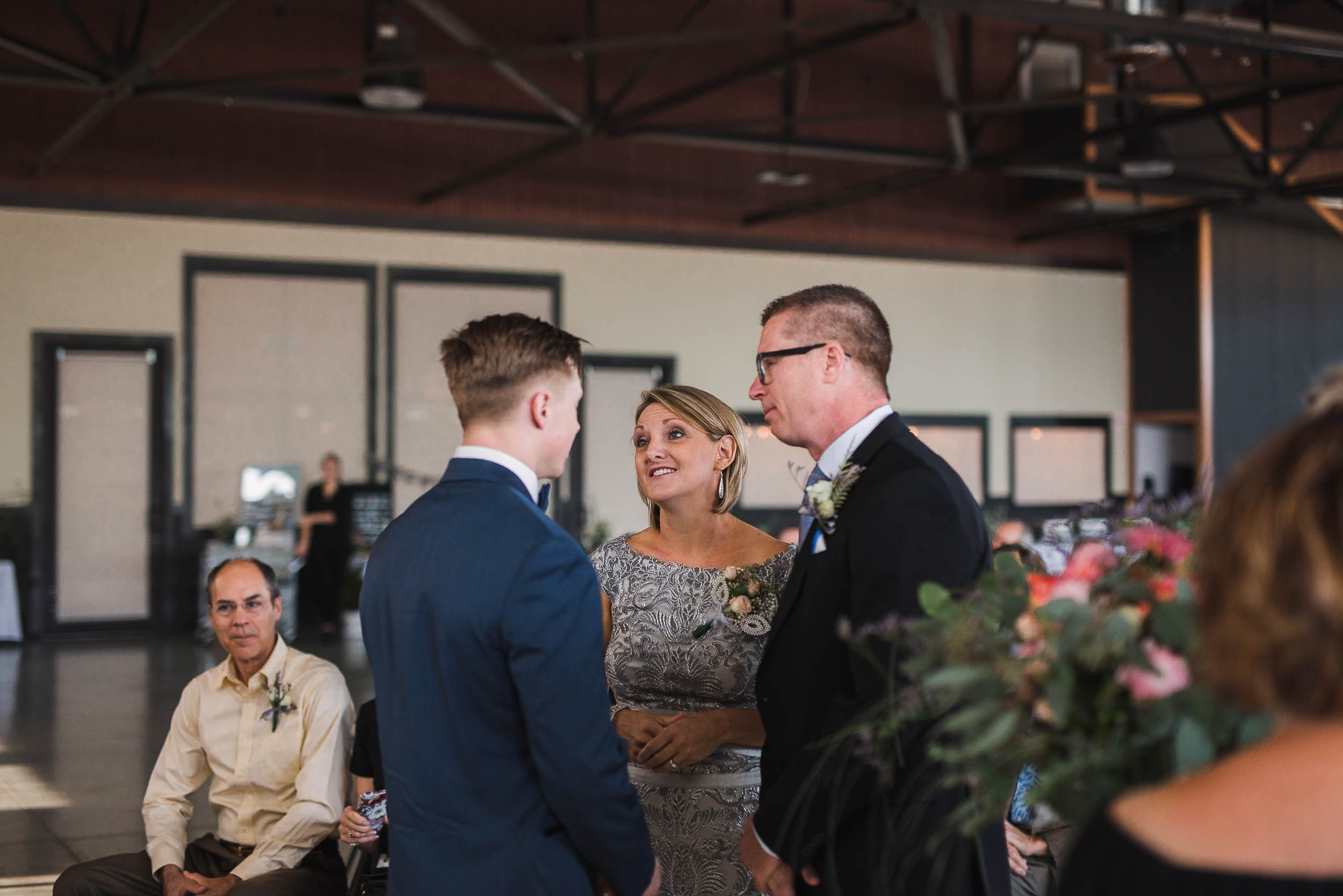 Groom and his parents at the ceremony