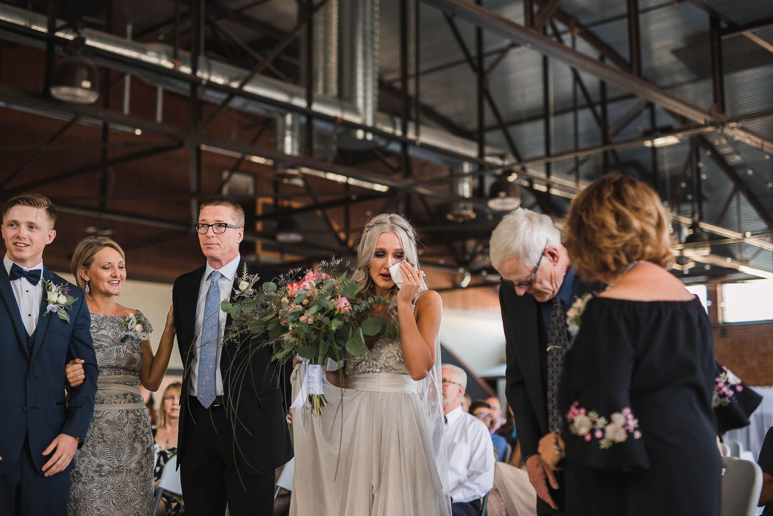 Emotional bride at wedding ceremony