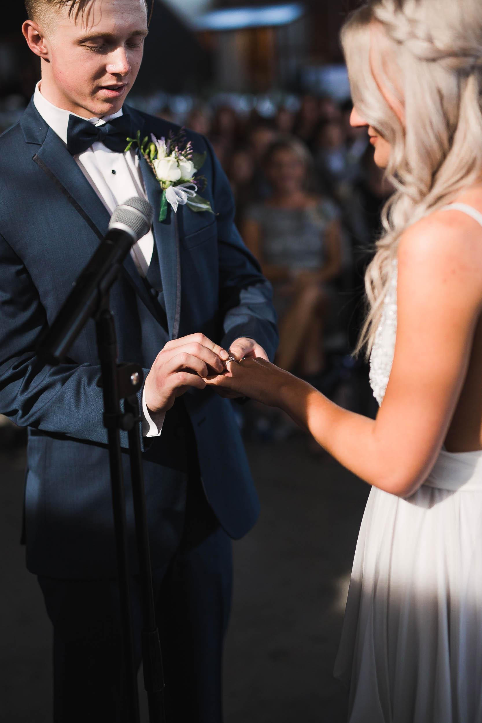 Exchanging rings Casper Wyoming Industrial Wedding
