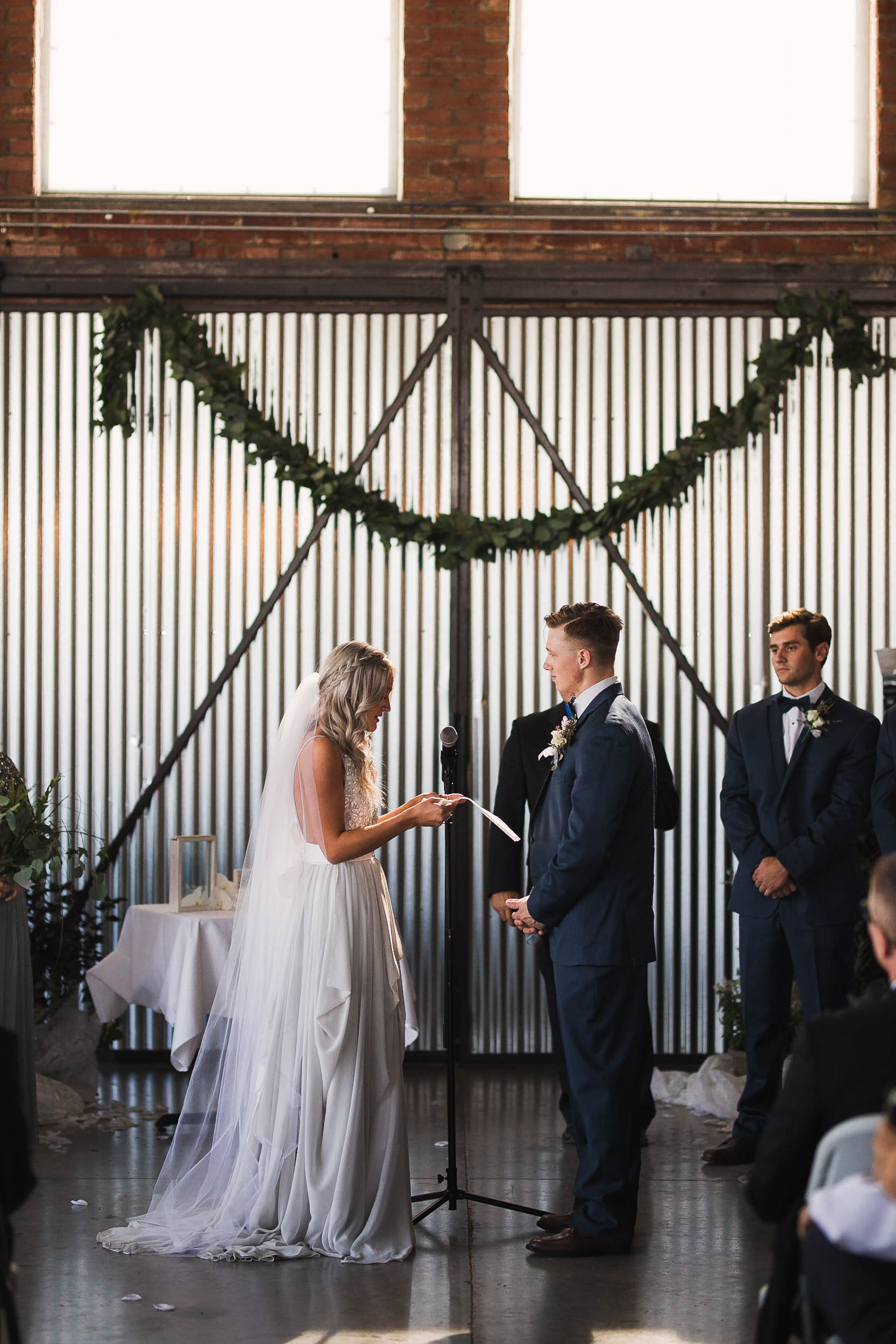 Bride reading vows to her groom