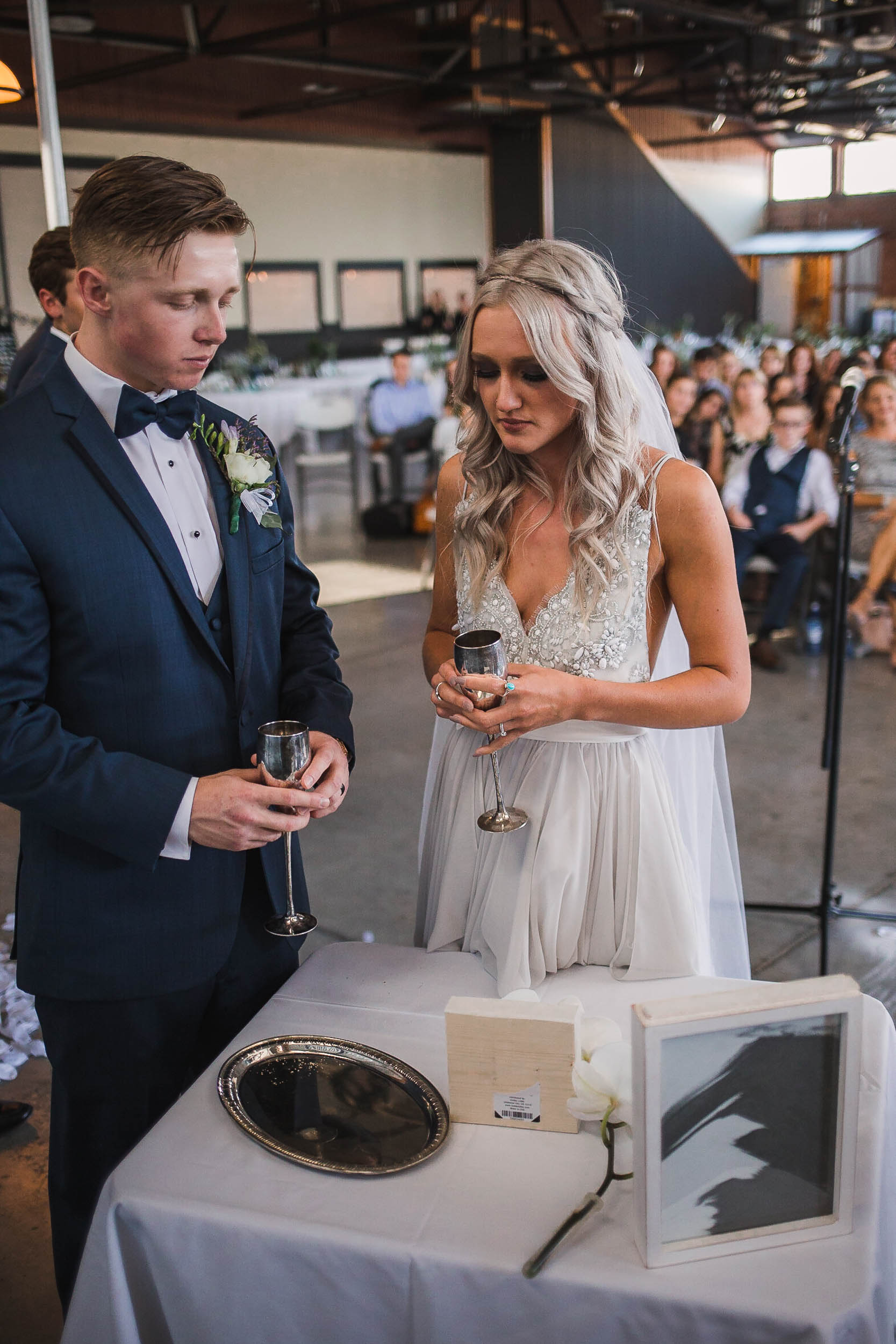 Bride and groom taking communion at their wedding ceremony