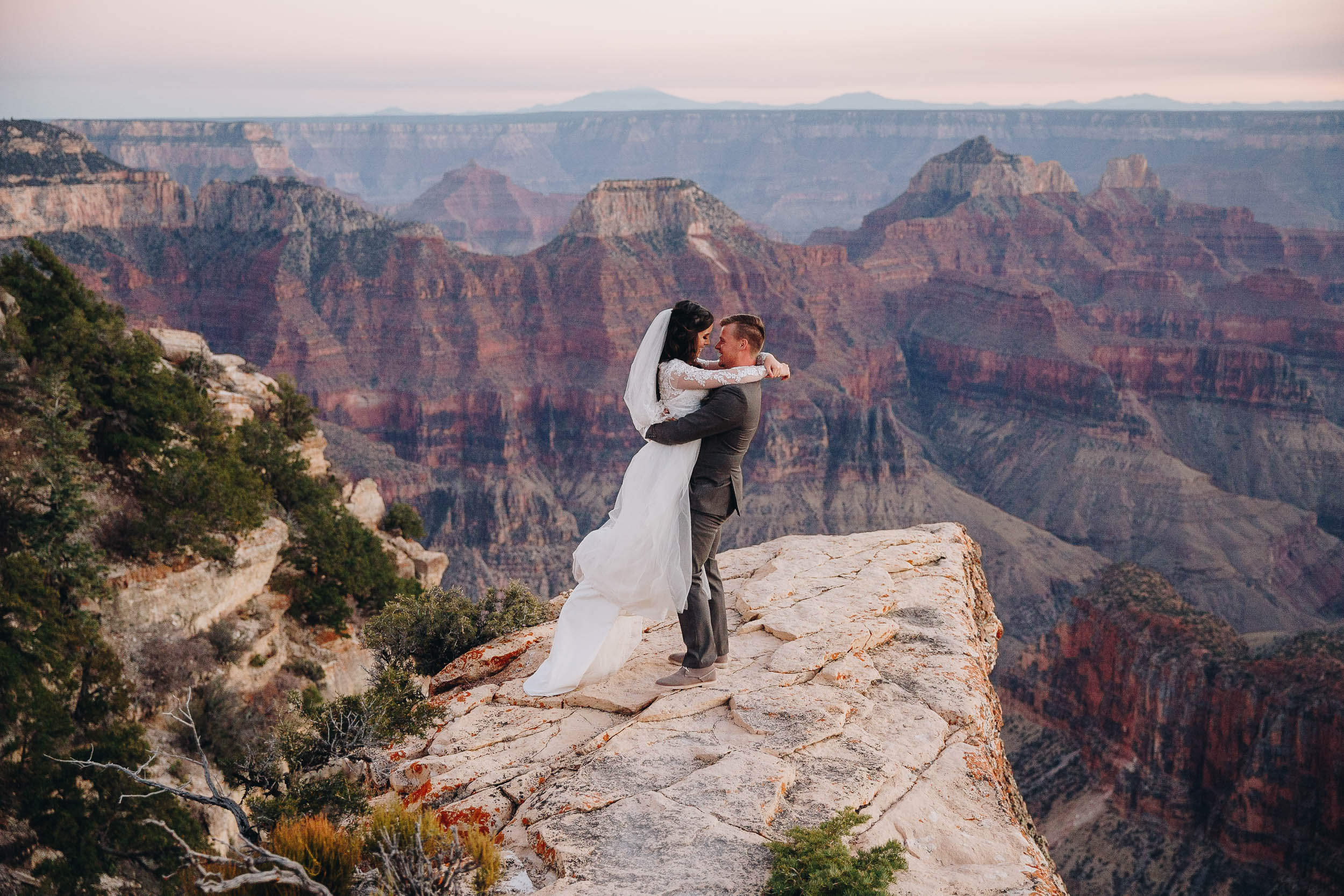 Bride and groom intimate wedding portrait in front of epic view of the Grand Canyon