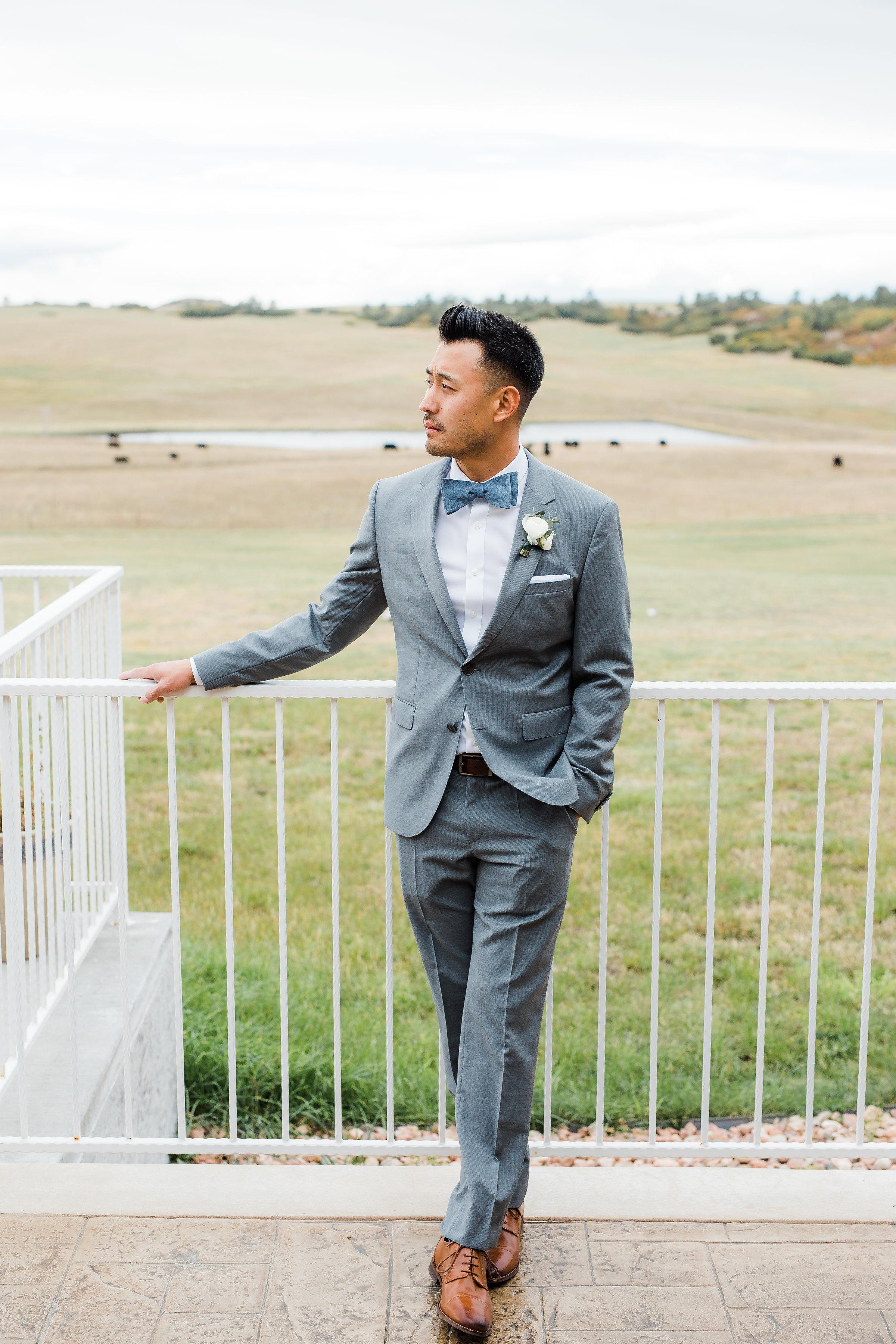 Classy asian groom portrait Flying Horse Ranch wedding