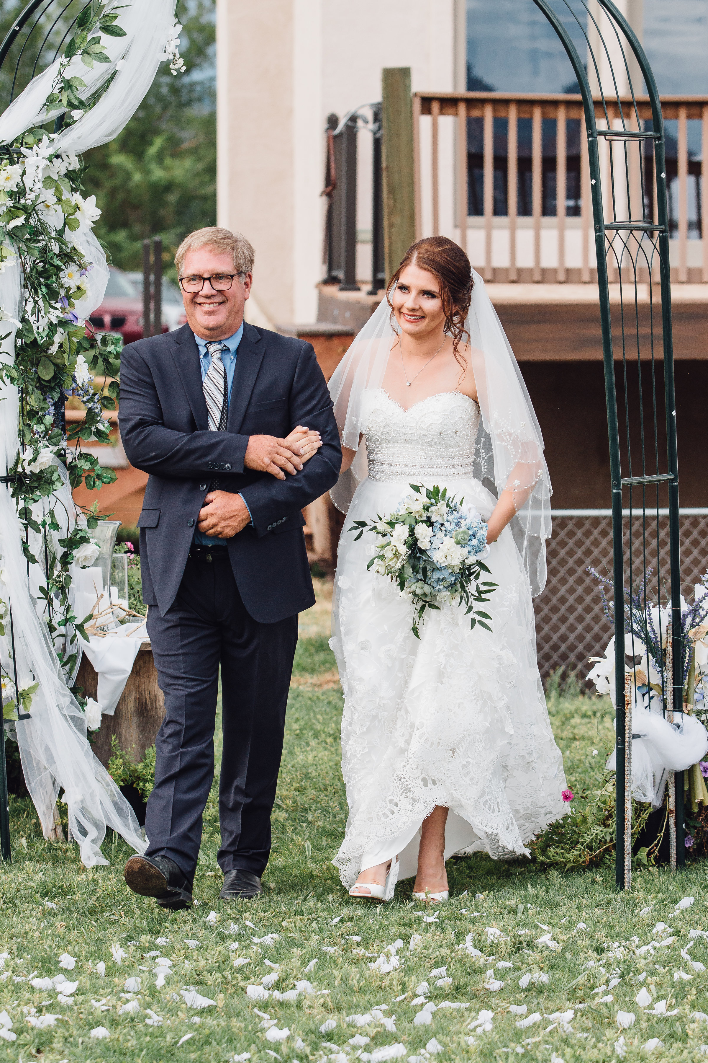 Colorado Bride walking down the isle with her father