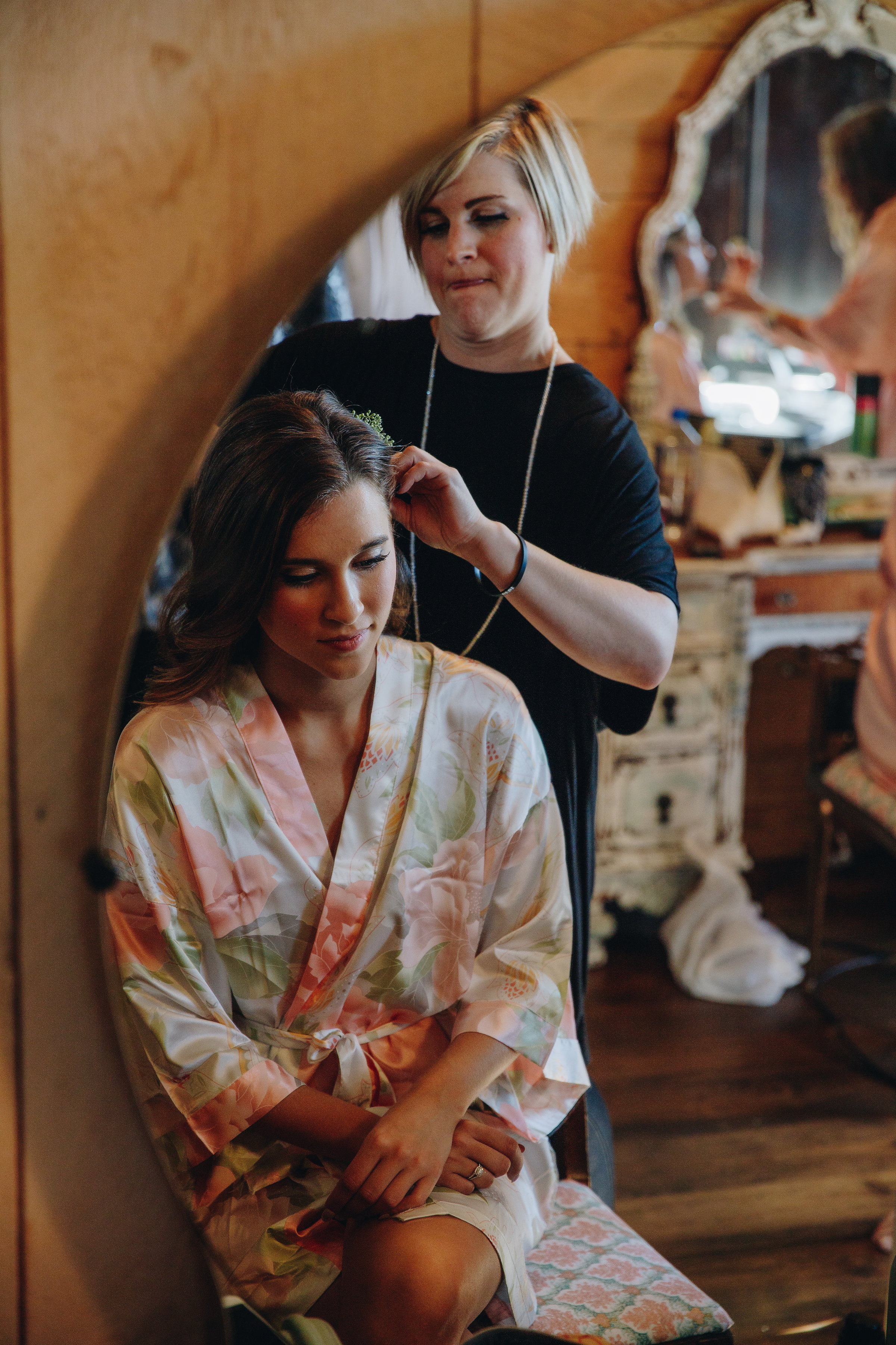 Twin Cities bride getting her hair done on her wedding day