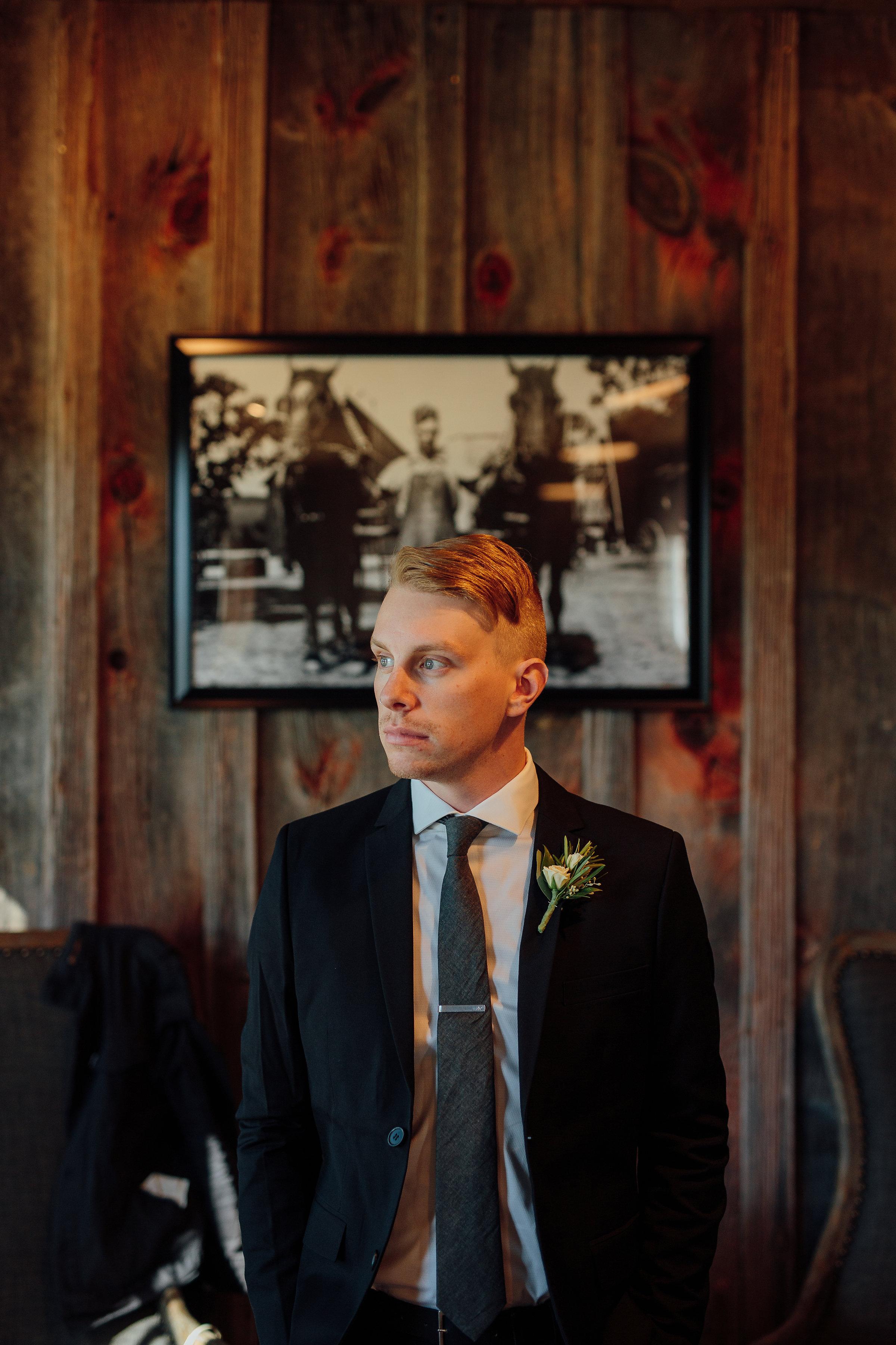 Modern portrait of a groom at his wedding near St. Paul Minnesota