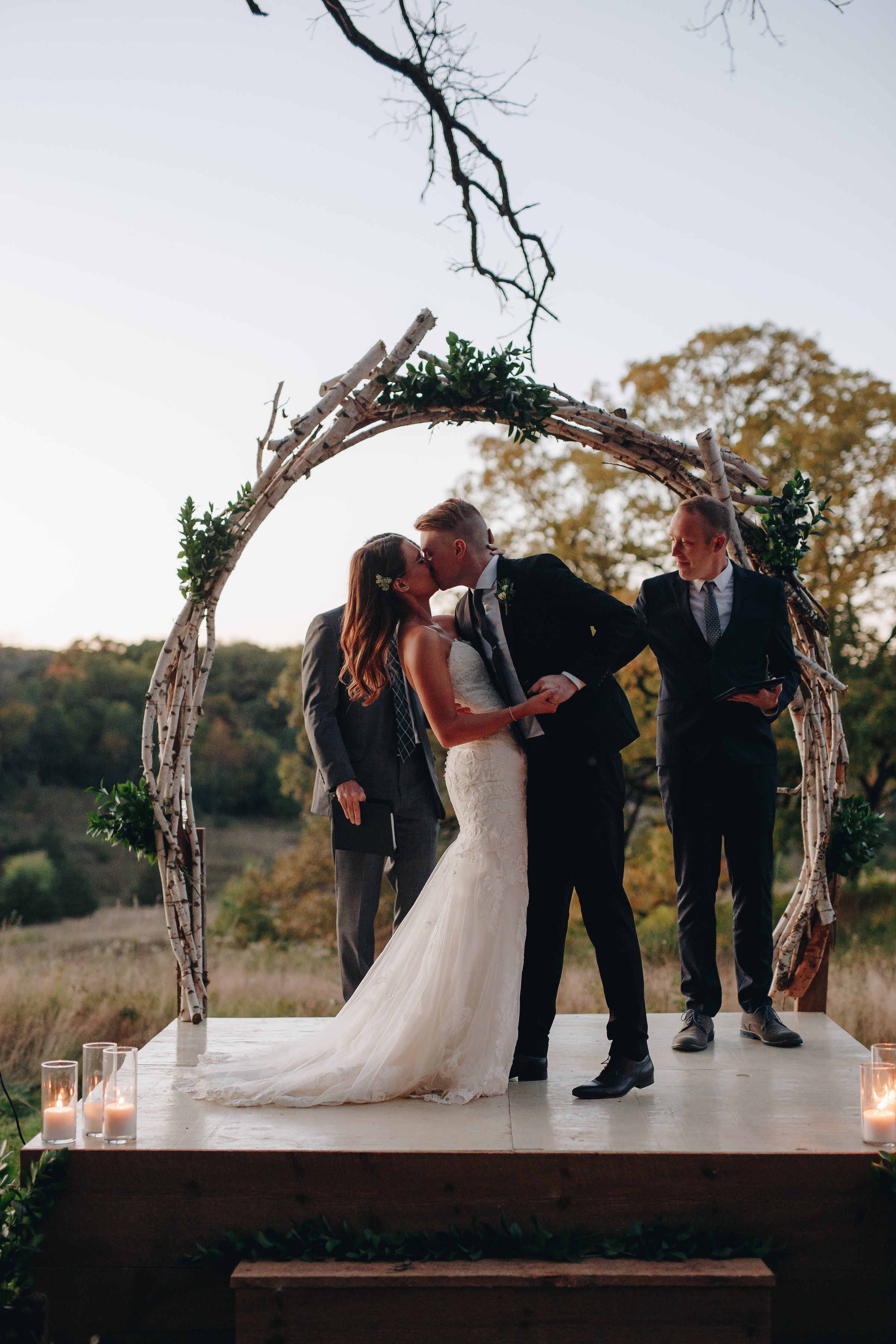 Bride and groom first kiss at wedding ceremony adventure wedding photographers Minnesota