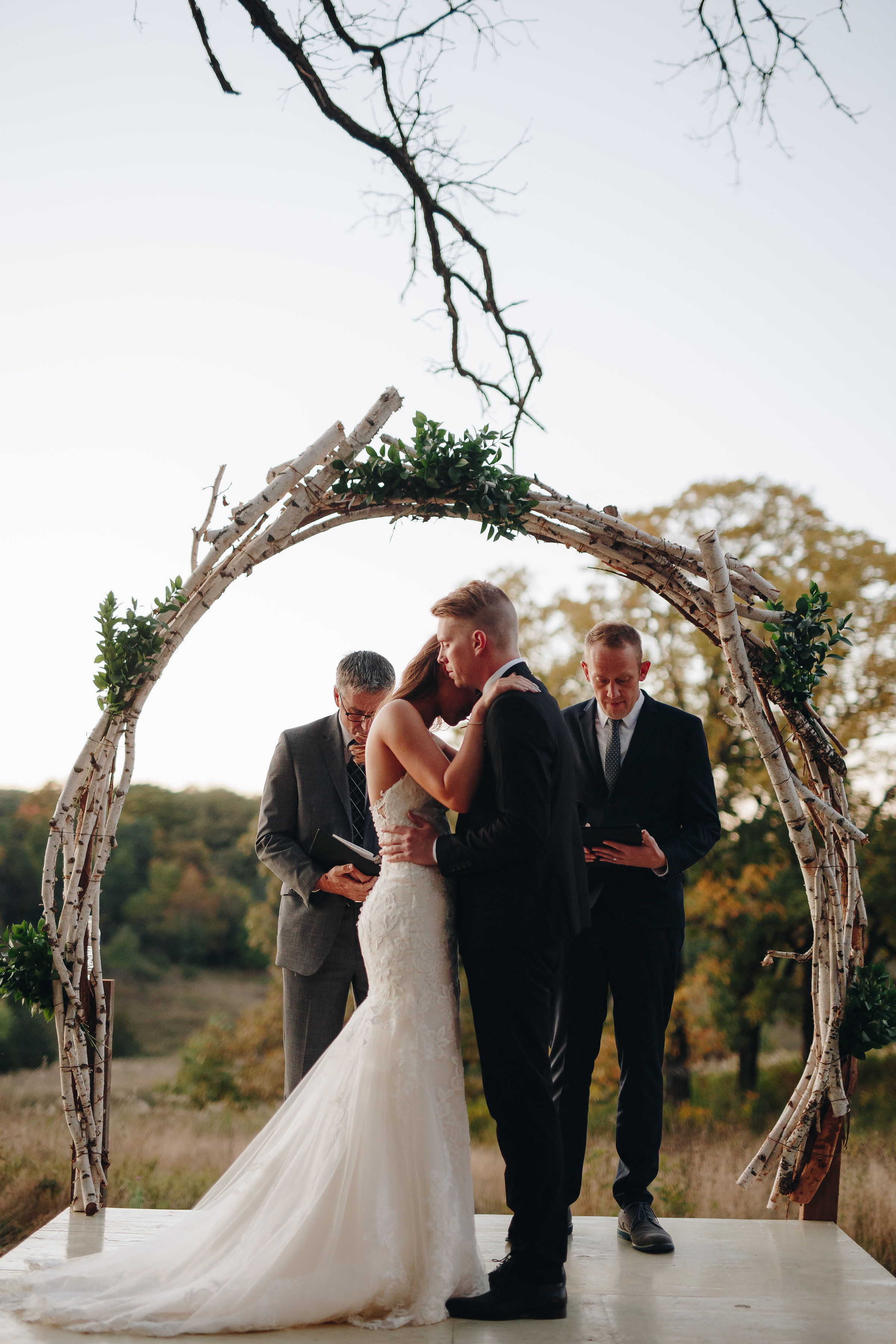 Intimate wedding ceremony moment after sunset in outdoor minneapolis wedding