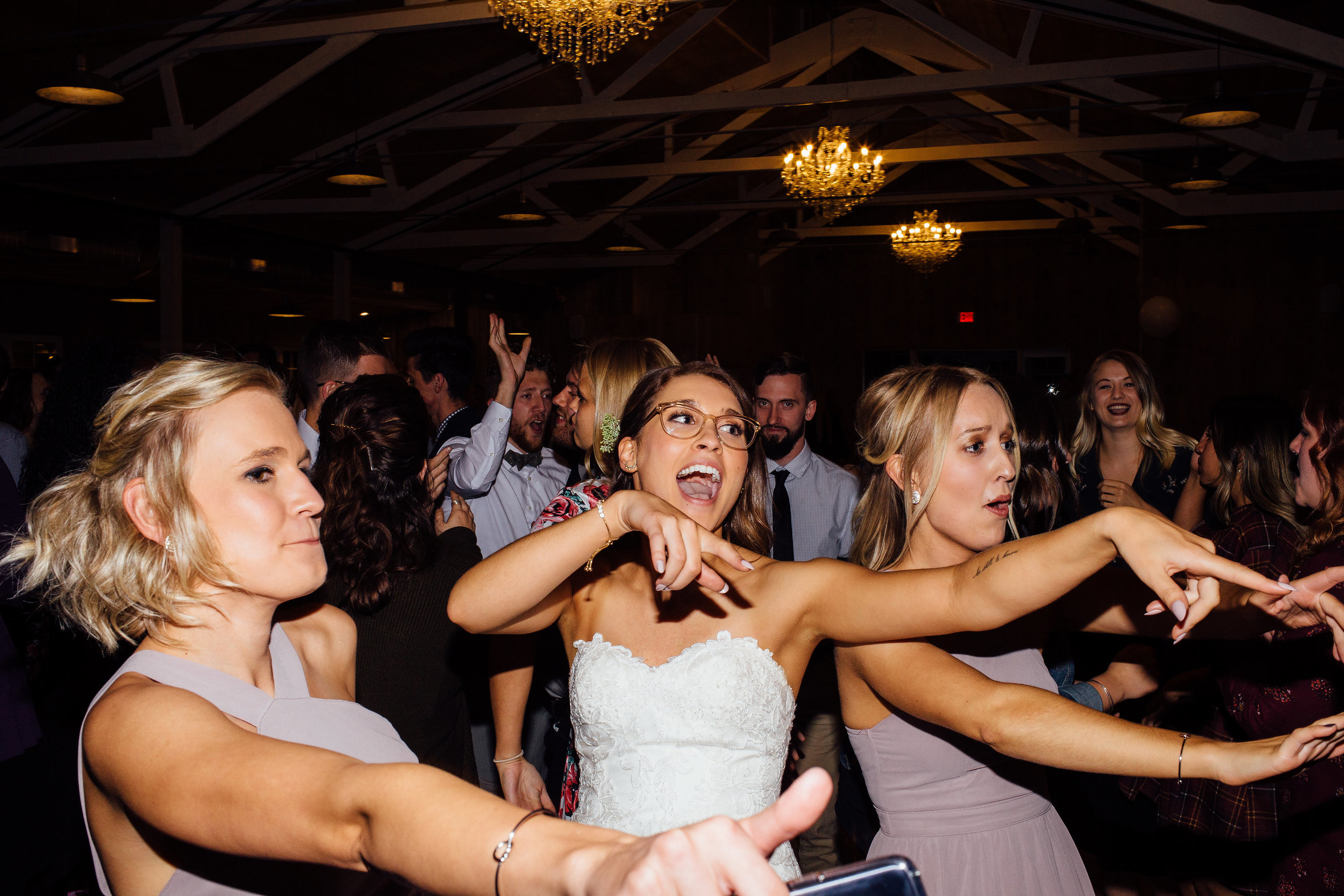 Bride singing along with live band at her wedding reception near the Twin Cities