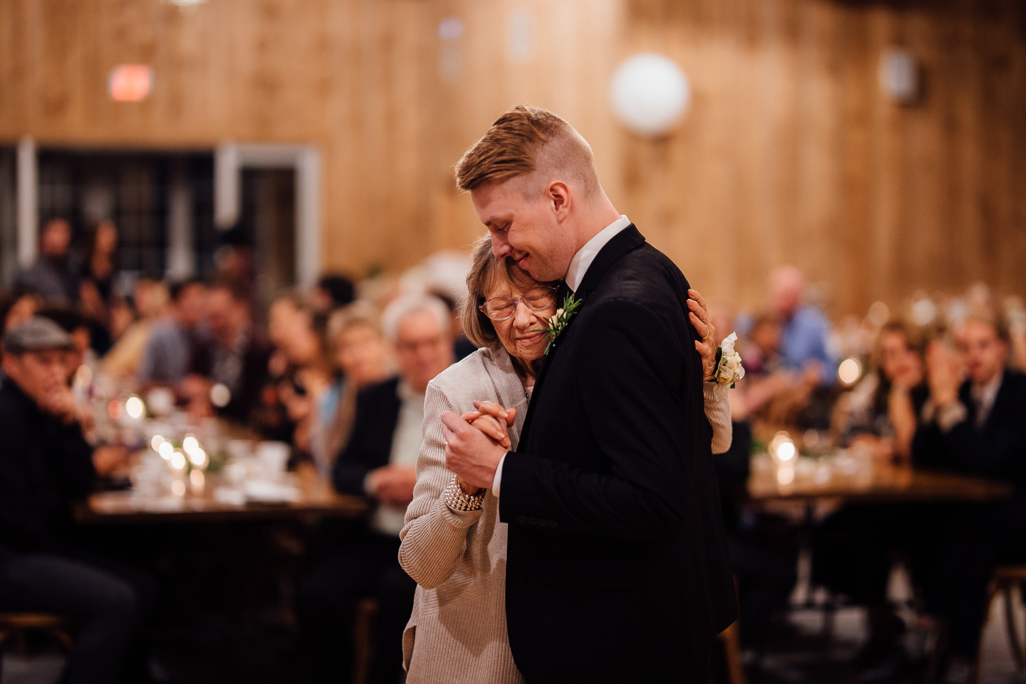 Groom dancing with grandma wedding moments captured by photographer