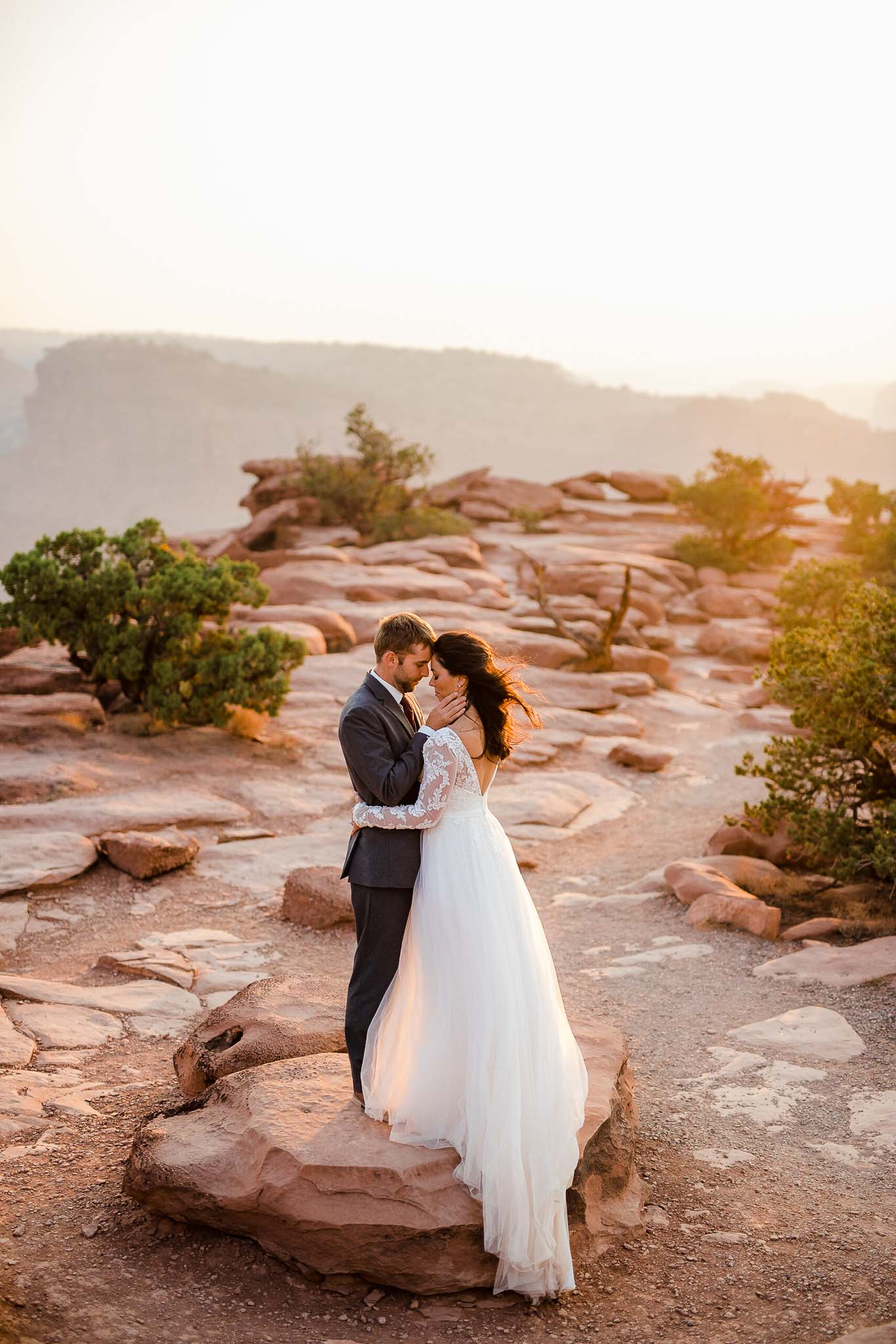 Bride and Groom share a tender embrace at Capitol Reef National Park, Utah