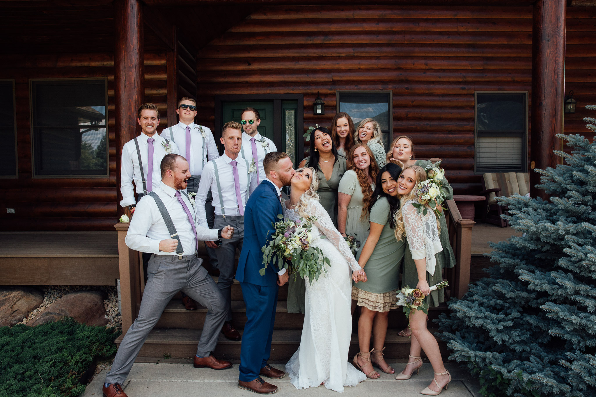 Wedding party poses for silly photo with Bride and groom