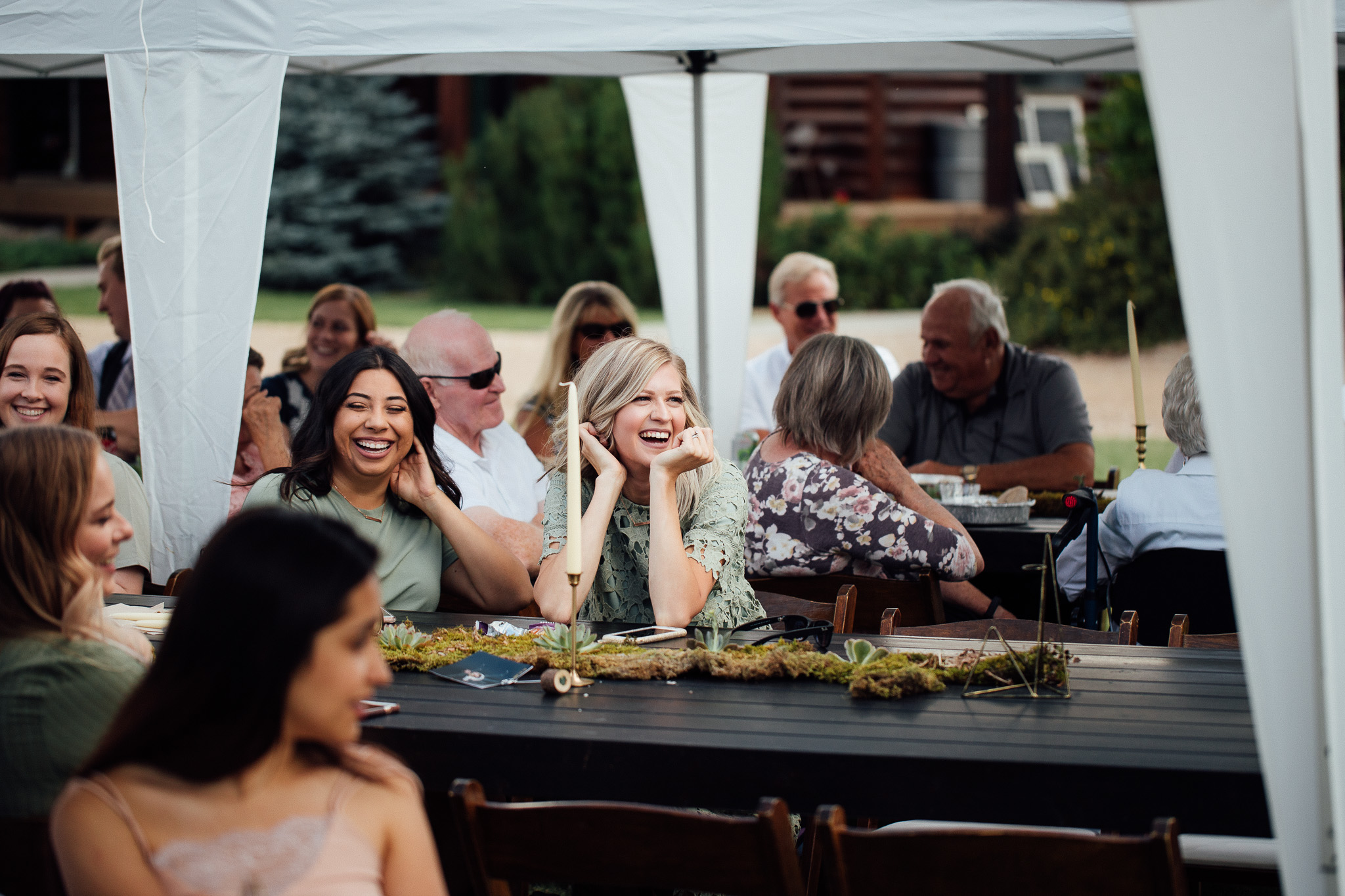 Wedding guests mingle during dinner