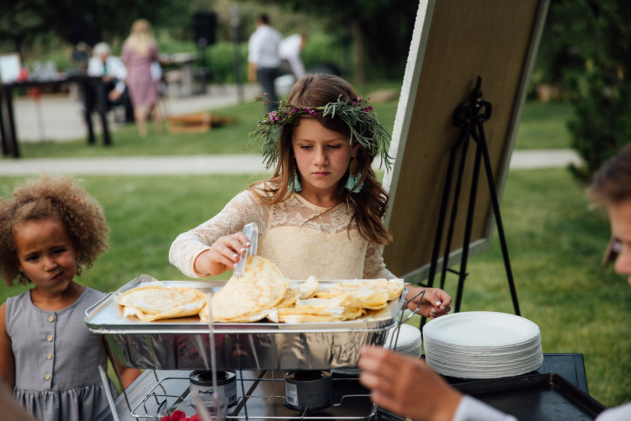 Flower girl makes a crepe during wedding reception