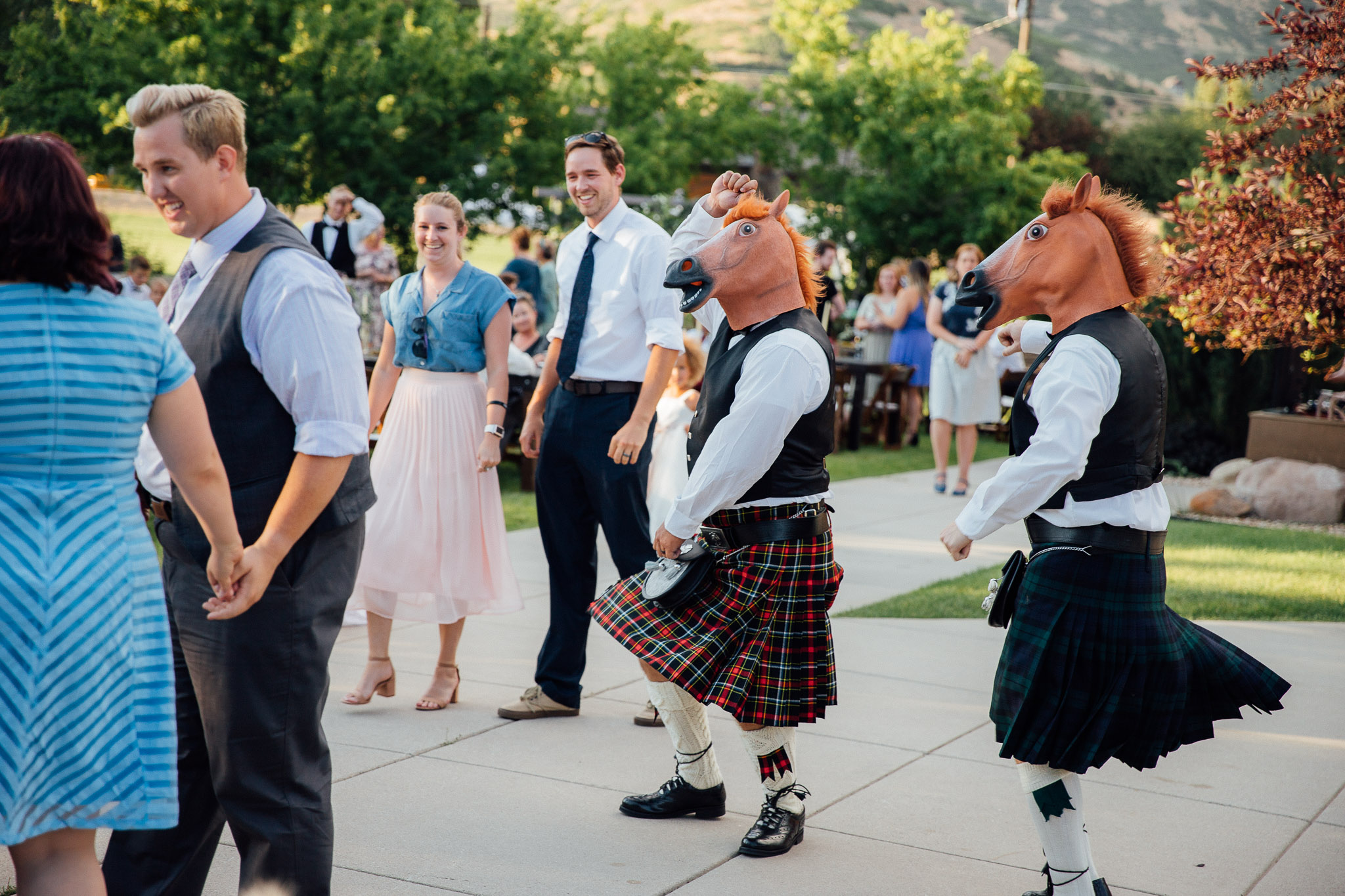 Guests dance at wedding reception