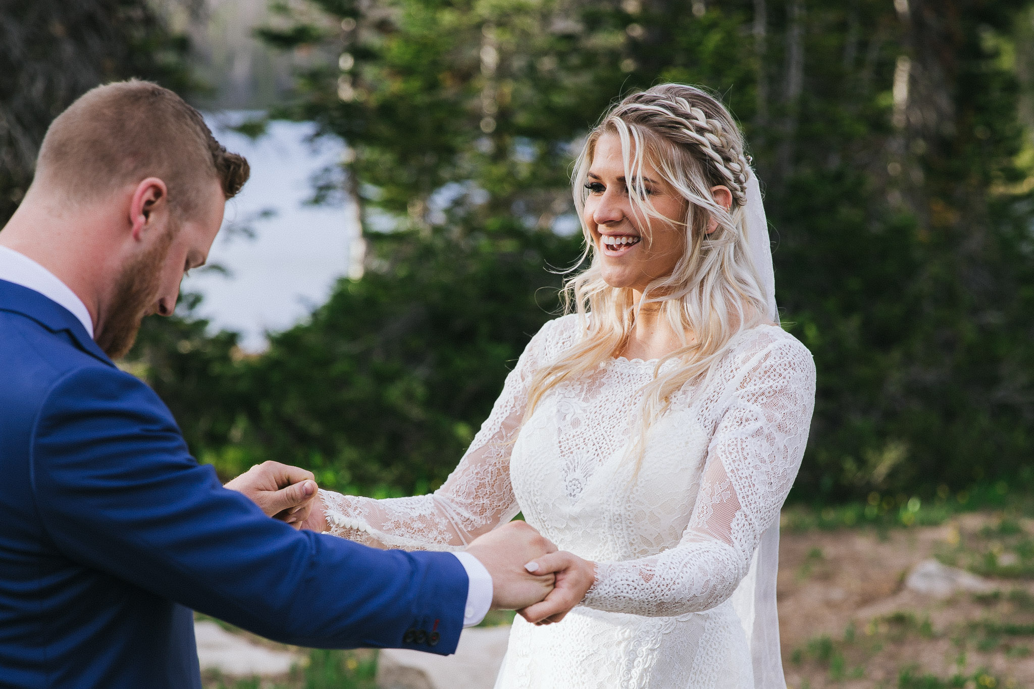 Bride and Groom share their first look at Mirror Lake in the Utah Mountains