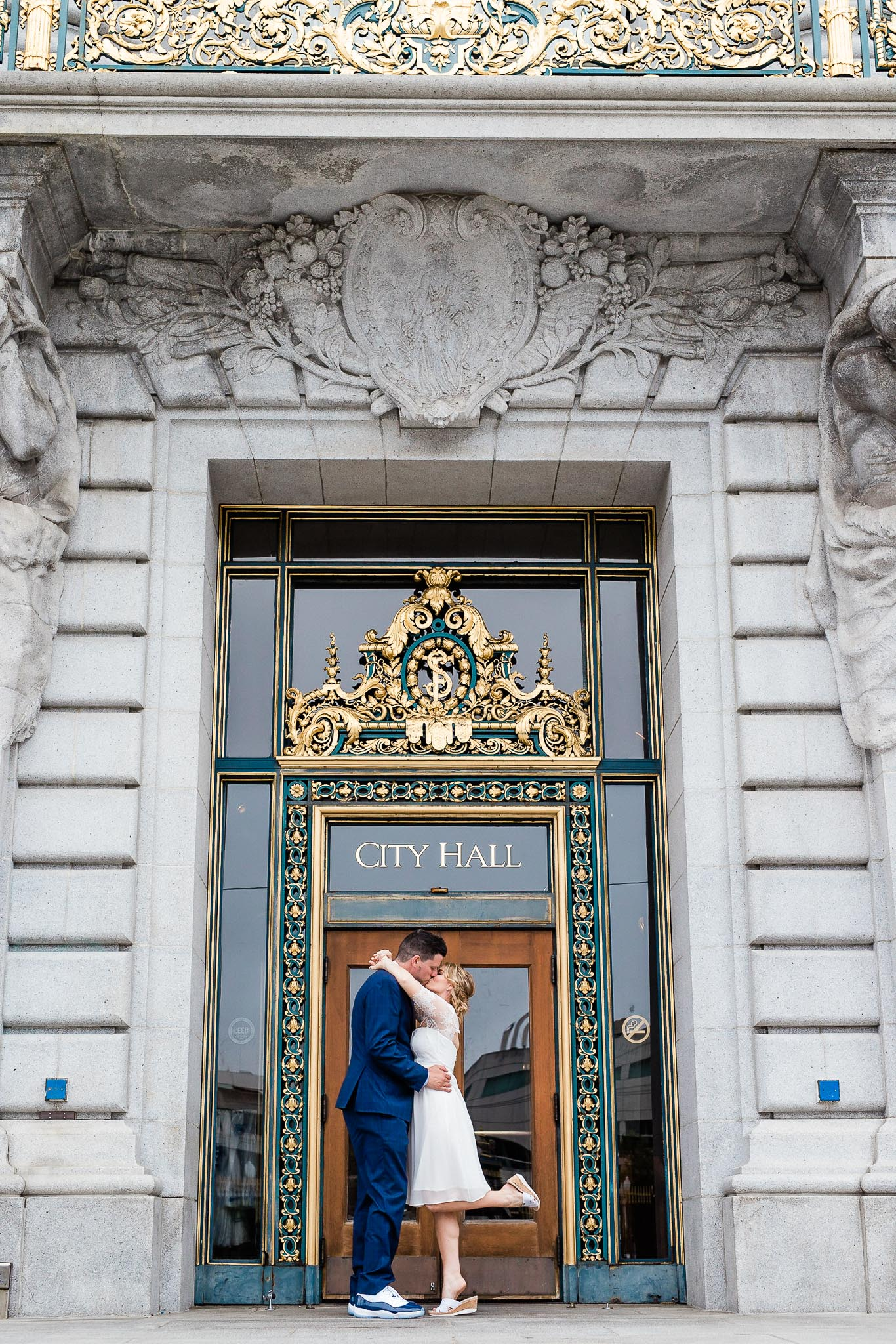 Bride and Groom pose for wedding portraits in San Francisco City Hall