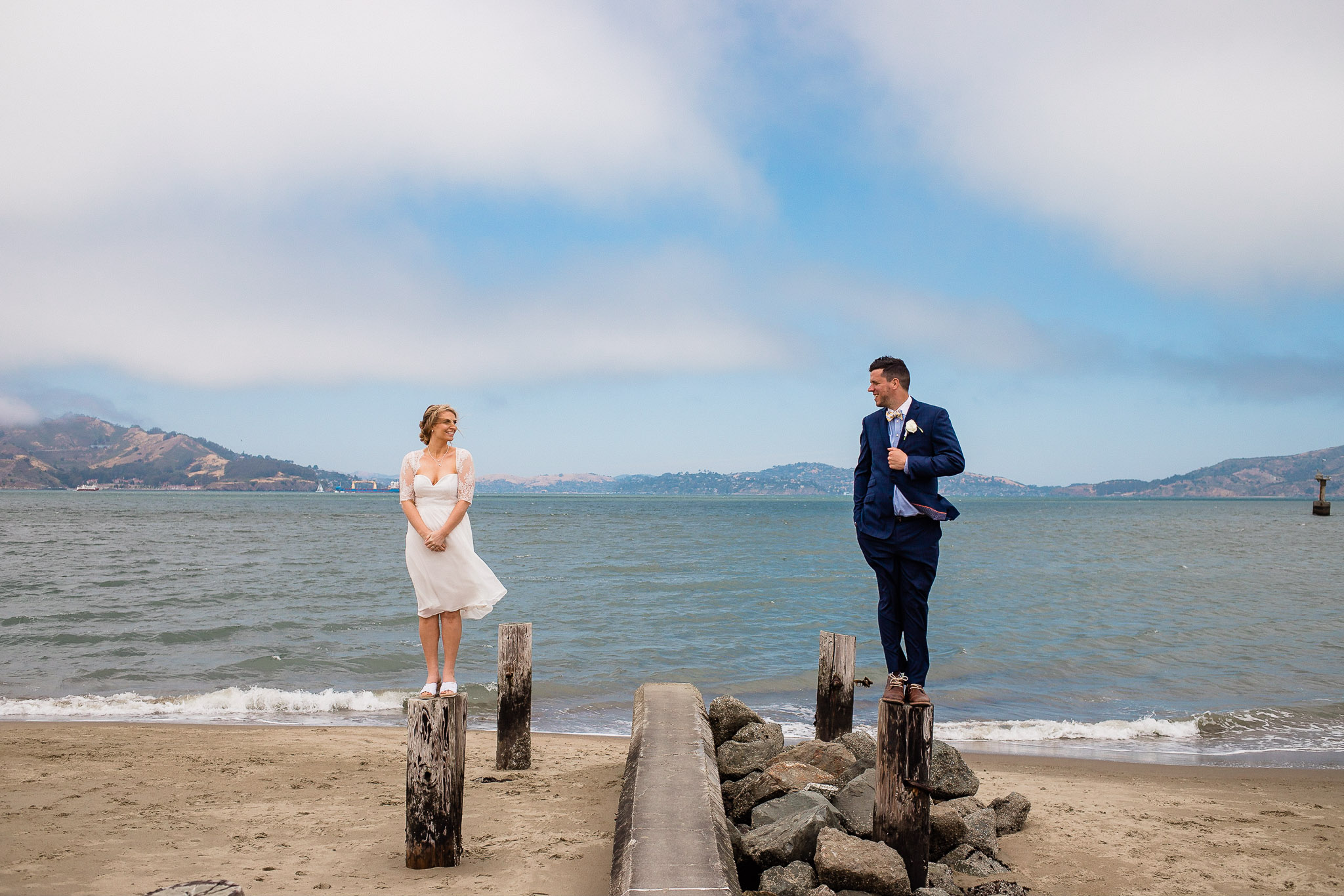 Bride and Groom pose for wedding photos near the Golden gate bridge