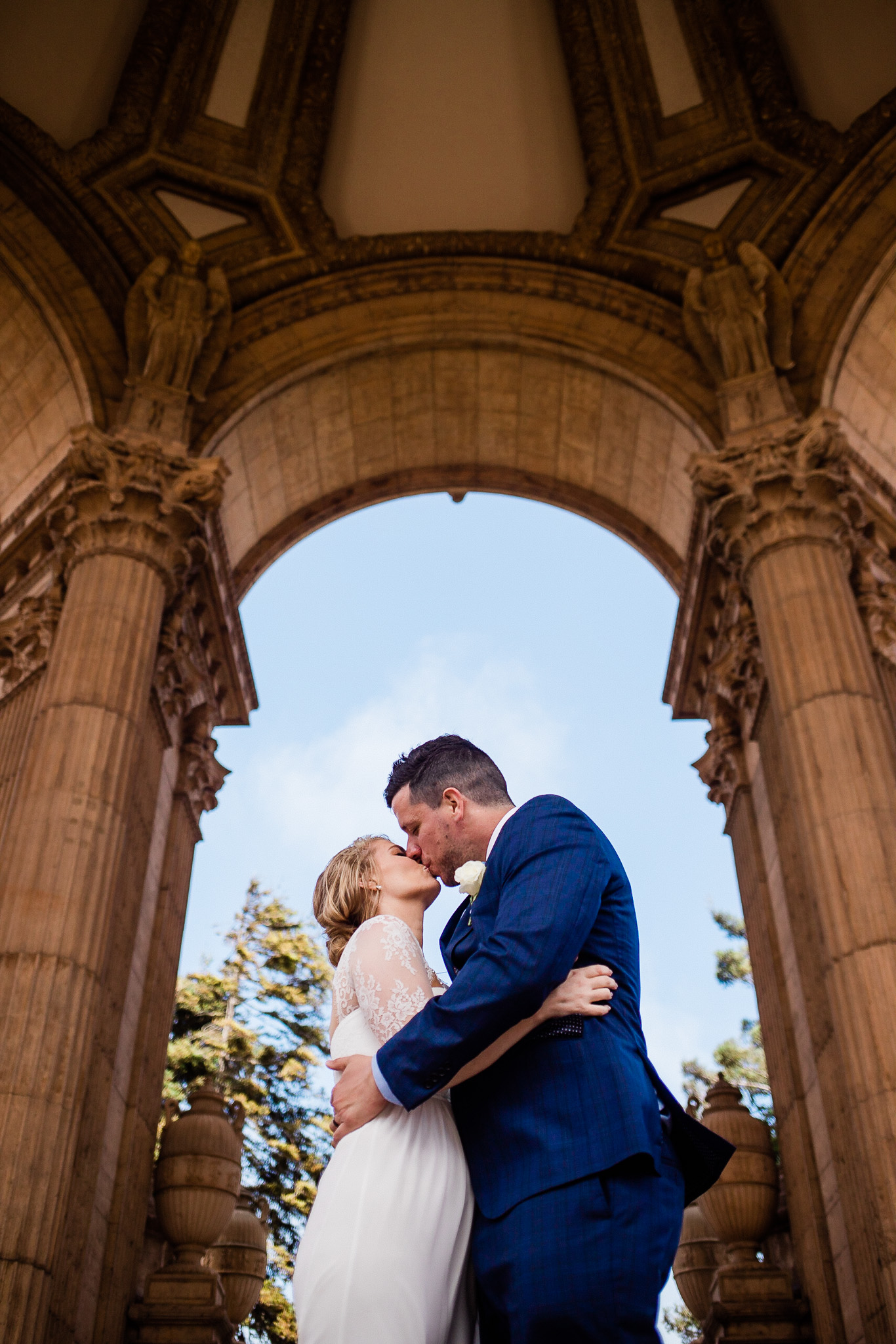 Bride and Groom pose for wedding photos near the Palace of Fine arts in San Francisco
