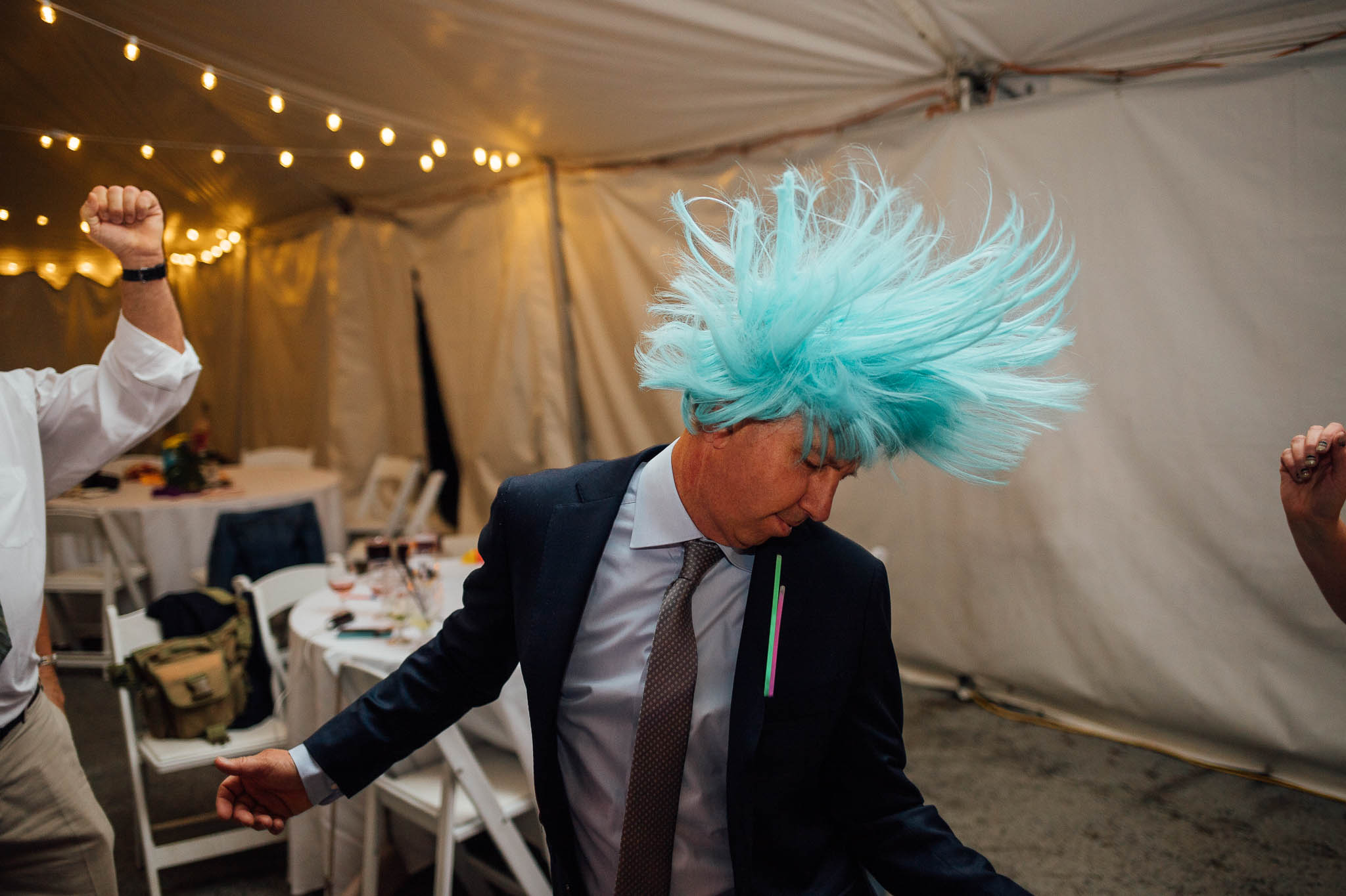 Wedding guest dancing with blue wig at wedding reception at Ten Peak Crested Butte Colorado
