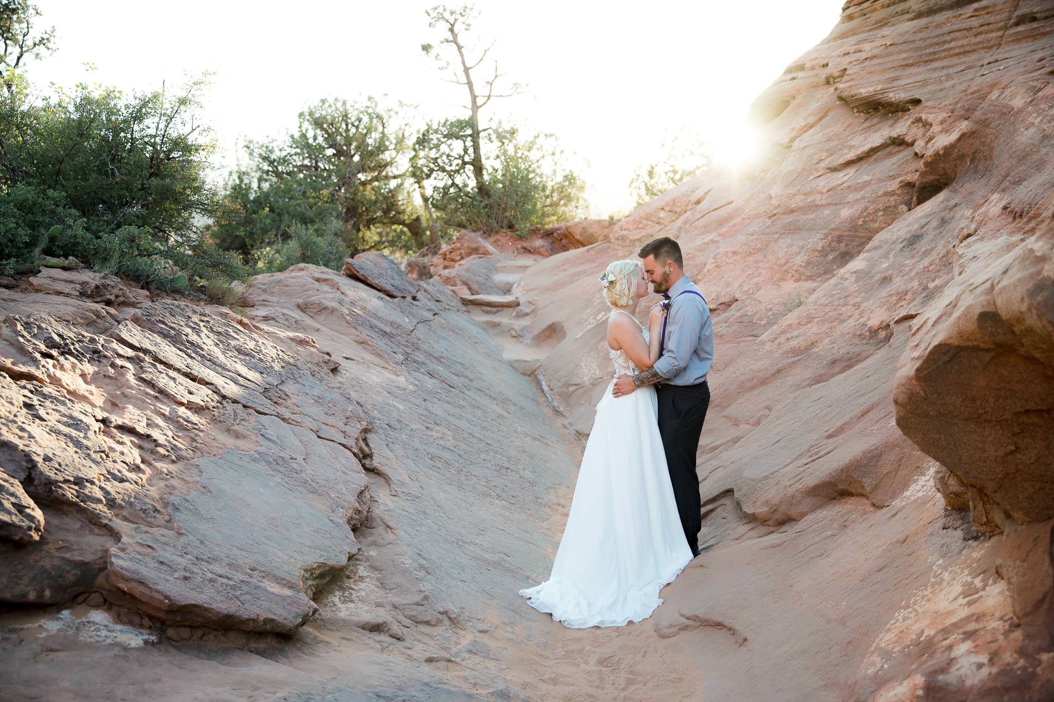 Couple snuggle after their elopement in Zion National Park