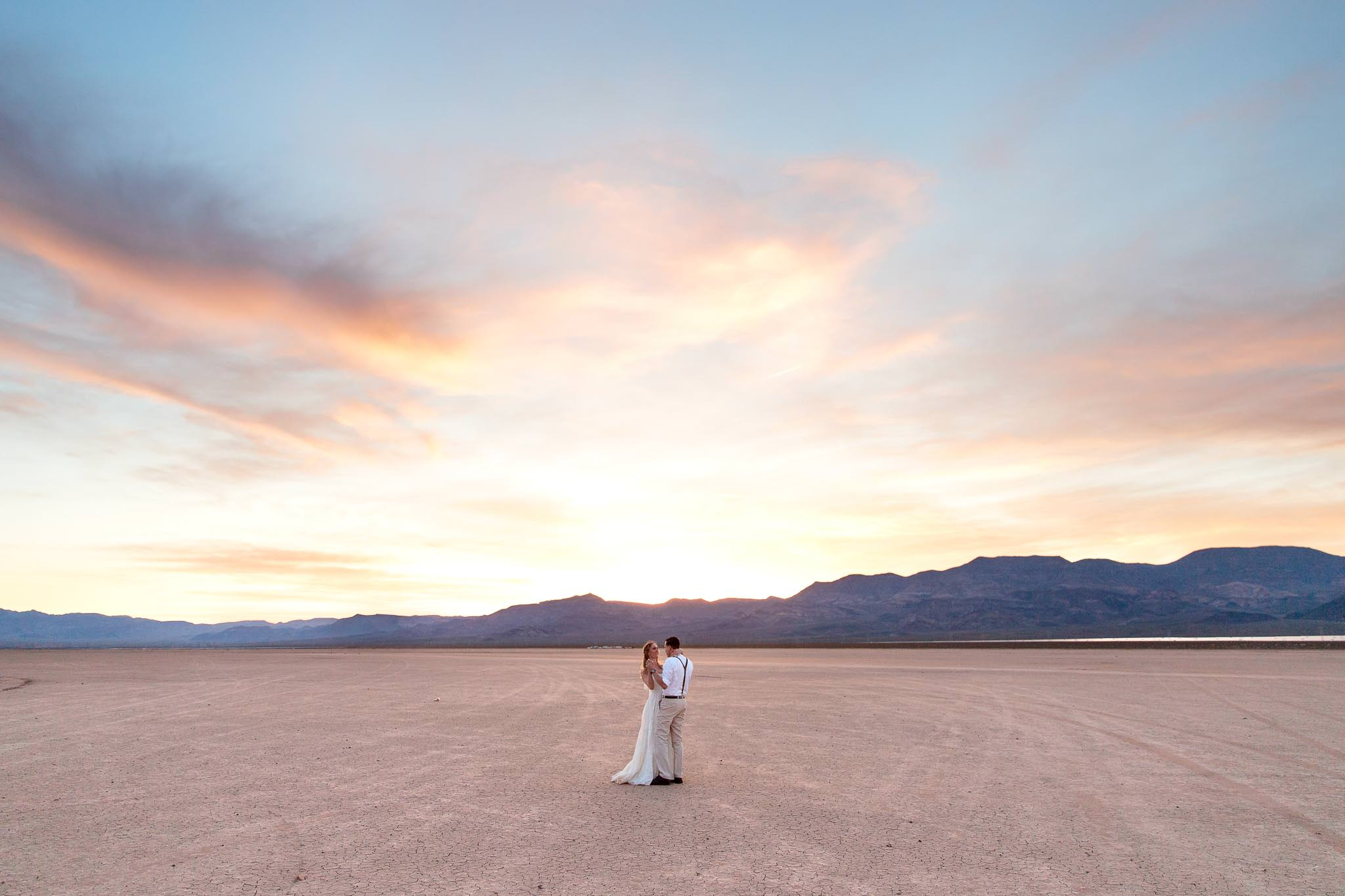 Bride and groom dance beneath a breathtaking sunset near Las Vegas Nevada elopement