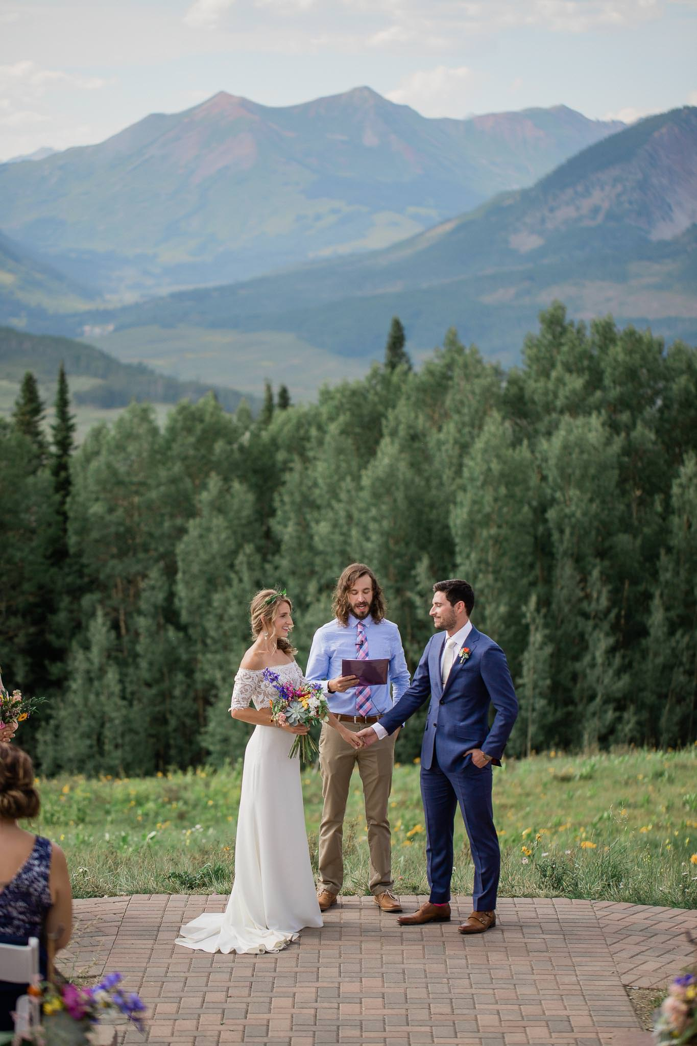 Epic adventure wedding ceremony in Crested Butte Colorado with mountain views