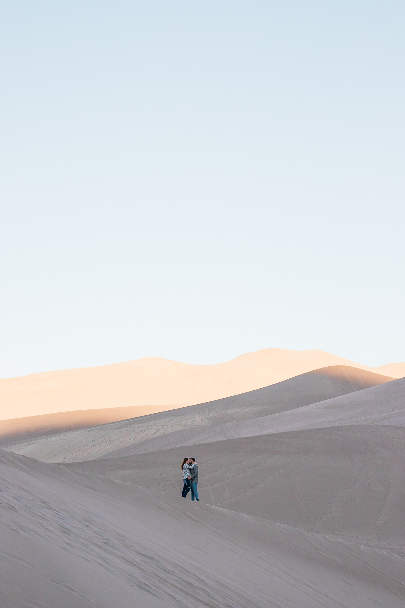 Epic sunrise engagement session in Great Sand Dunes National Park, Colorado