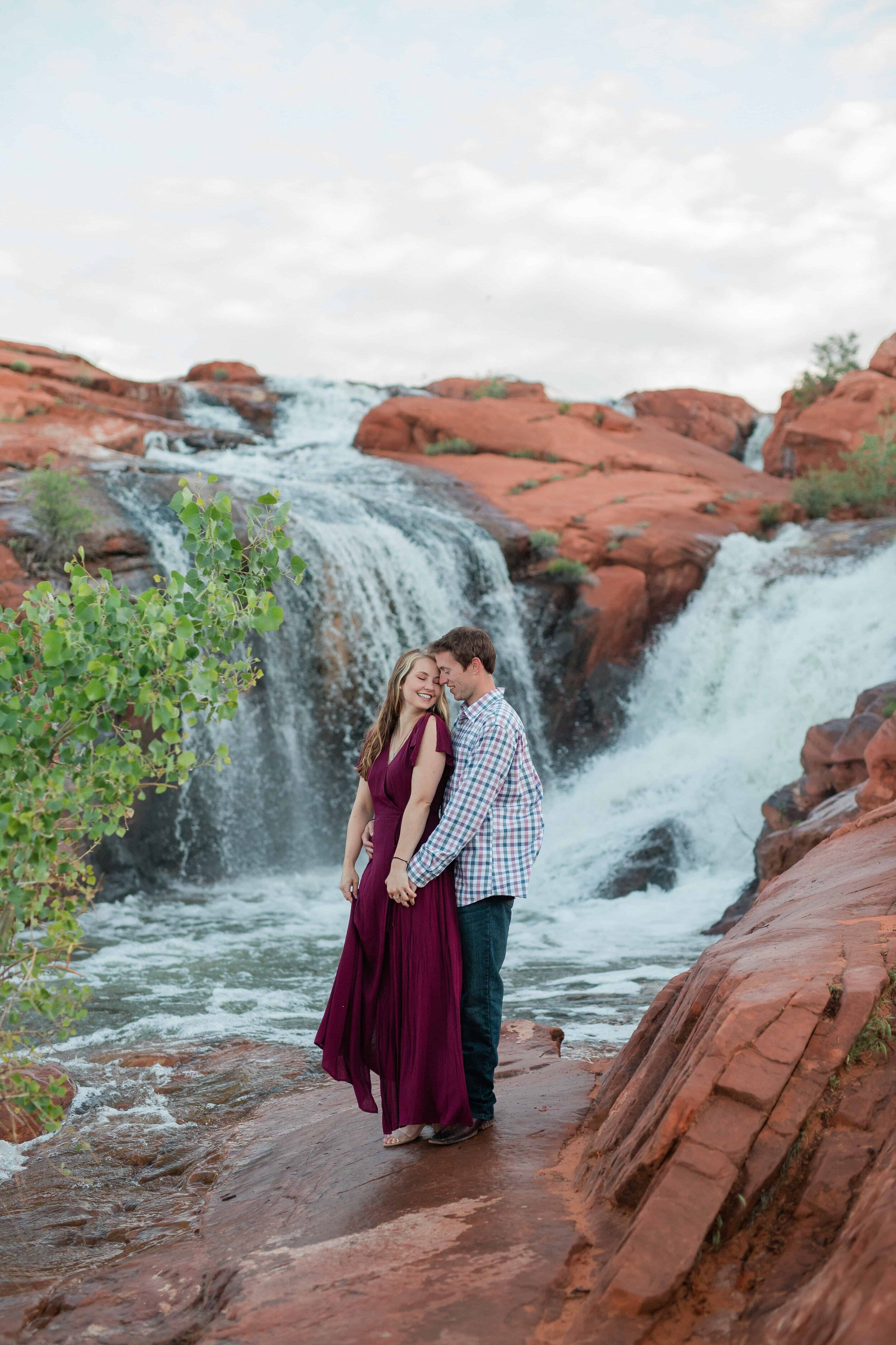Intimate portrait of couple snuggling during their adventure session at Vedauwoo Wyoming