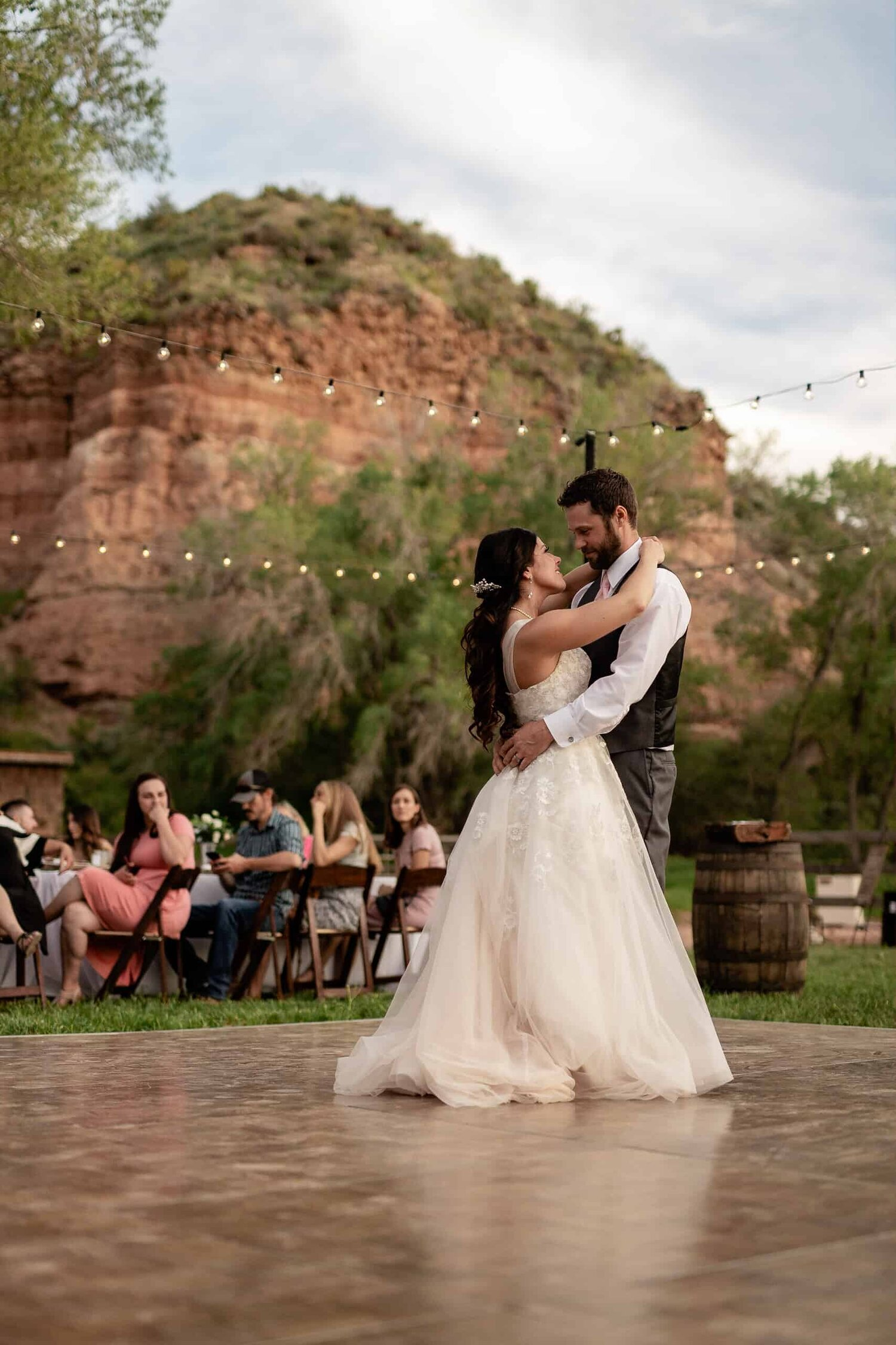 Bride and Groom share their first dance at their Utah outdoor wedding Red Rock Oasis, Rockville