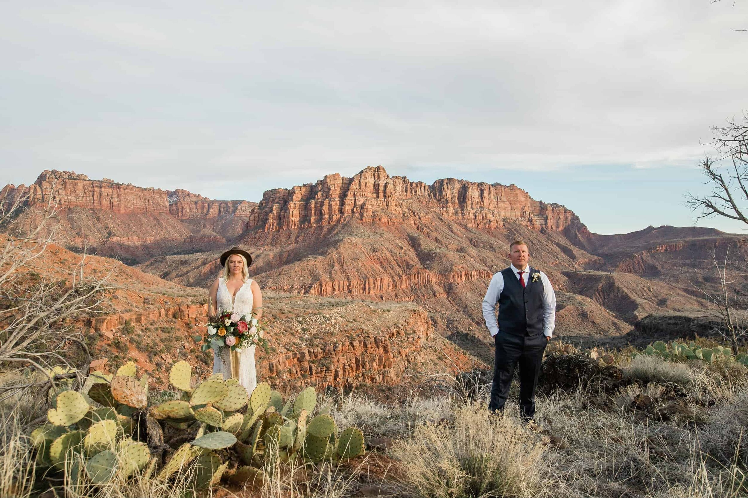 Bride and groom snuggle for wedding portrait in Zion National Park