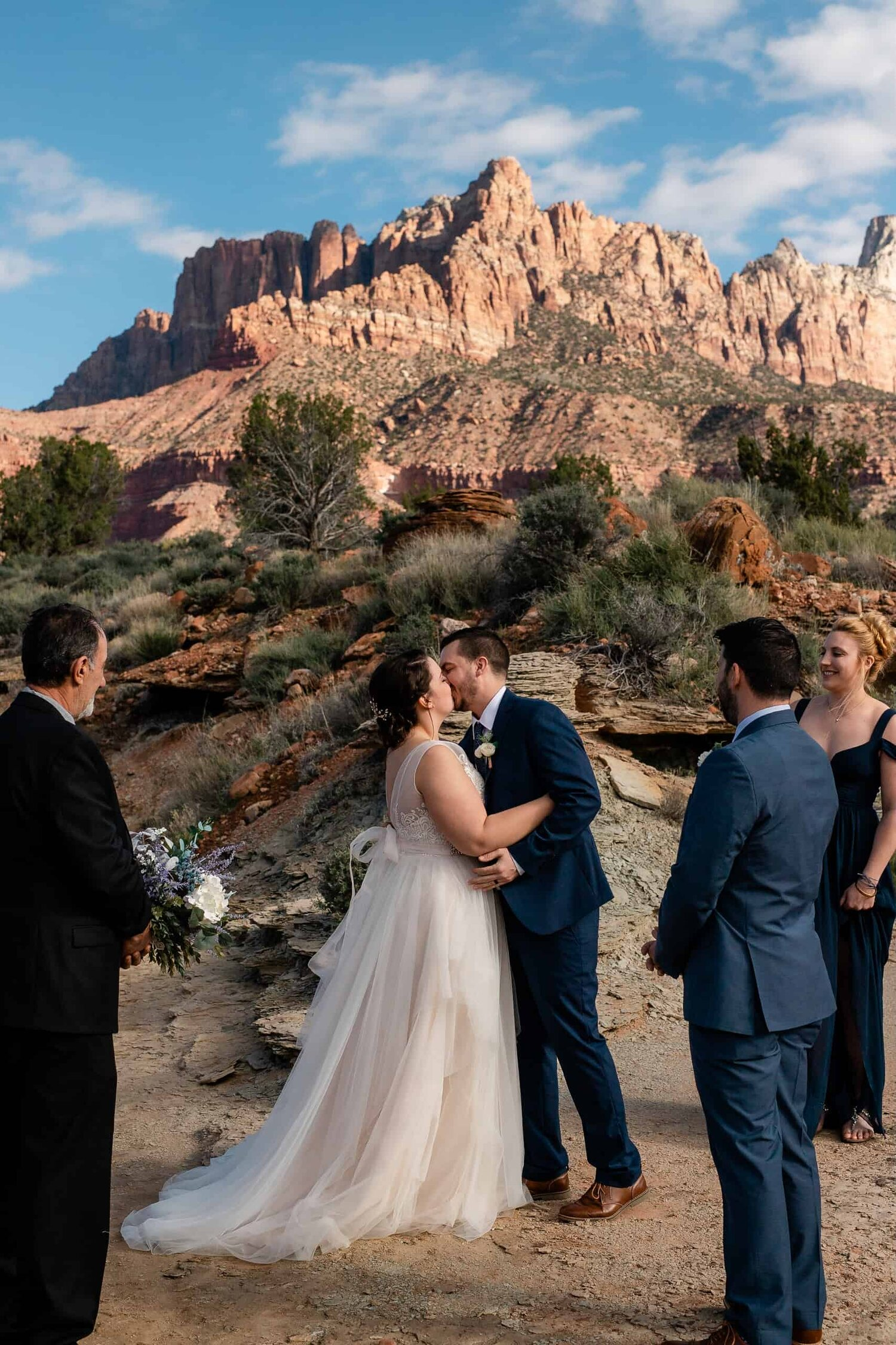 Bride and Groom kiss during their Zion National Park adventure elopement Wedding Photographers