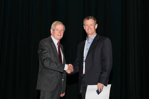 Dr Joe Geenty awarding the 2018 Begg Research Award to Dr Peter Miles