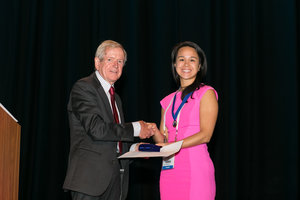 The Milton Sims Award winner Dr Doreen Ng receiving her award with Dr Joe Geenty