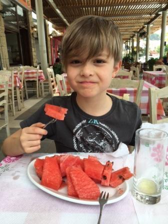 Ned eating karpouzi in Greece
