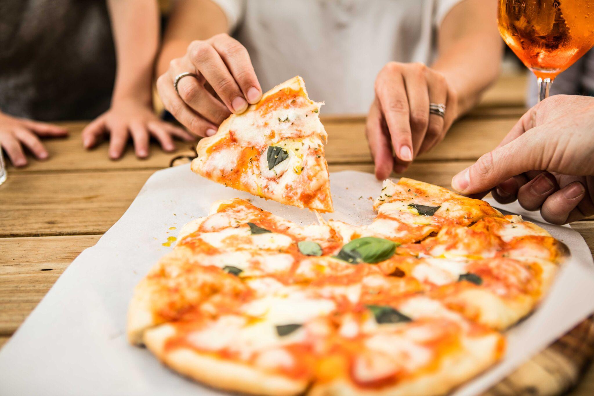 sun-urban-flat-iron-side-door-pizza.jpeg