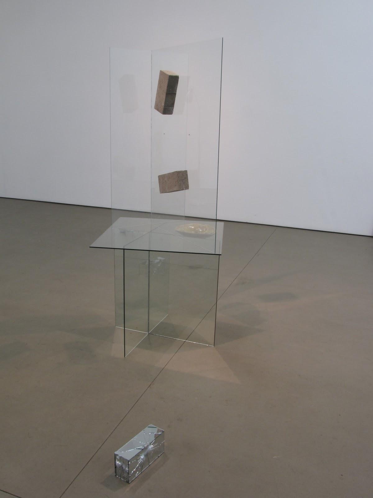 "Architect , 60"" x 22"" x 24"", transparent glass, mirror glass, found ashtray, concrete brick, silicon, 2010"